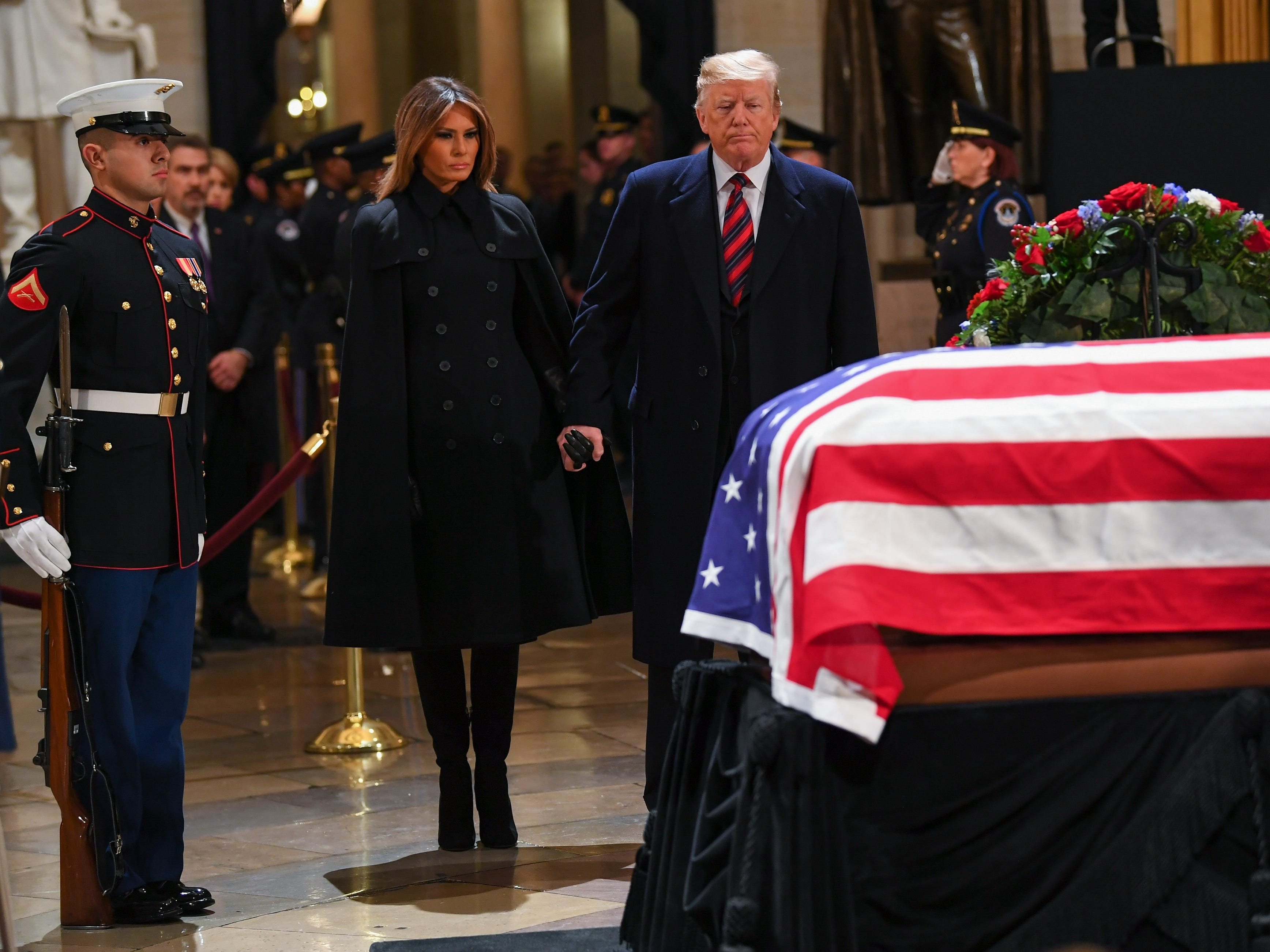 President Trump and First Lady Melania Trump pay their respects to former President George H.W. Bush as the 41st President lies in state at the U.S. Capitol Rotunda.