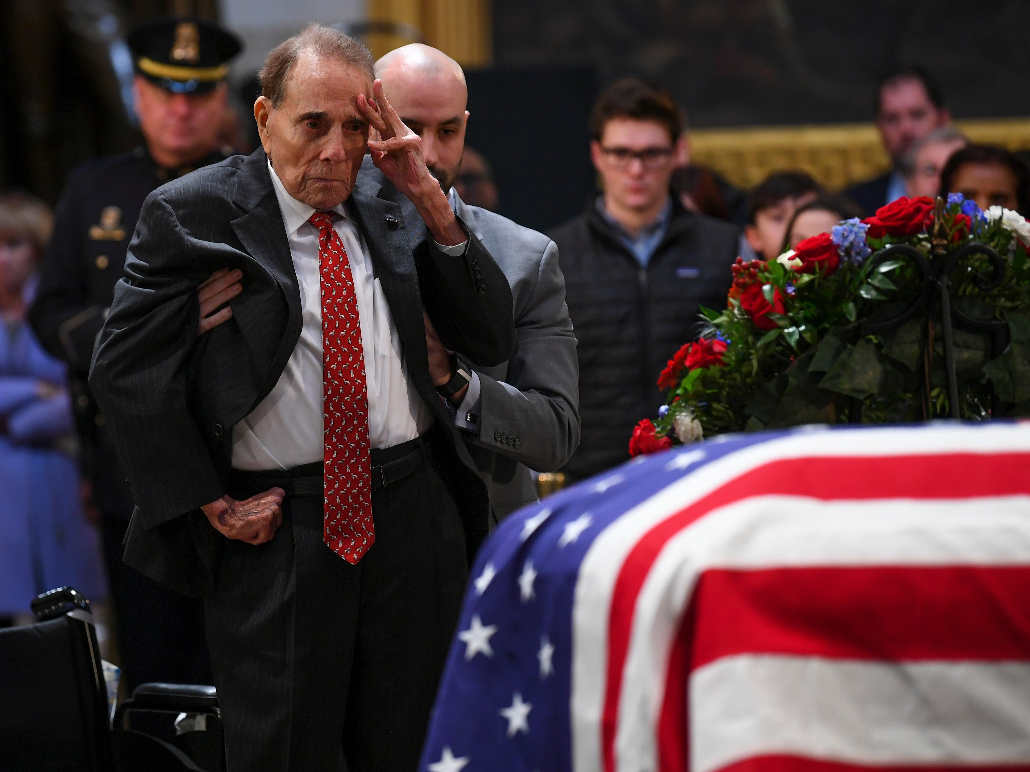 12/4/18 1:03:00 PM -- Washington, DC, U.S.A  -- Former Sen. Bob Dole salutes the casket of President George H.W. Bush who lies in state at the U.S. Capitol Rotunda. --    Photo by Jack Gruber, USA TODAY staff ORG XMIT:  JG 137685 Arrival and Fune 12/4 (Via OlyDrop)