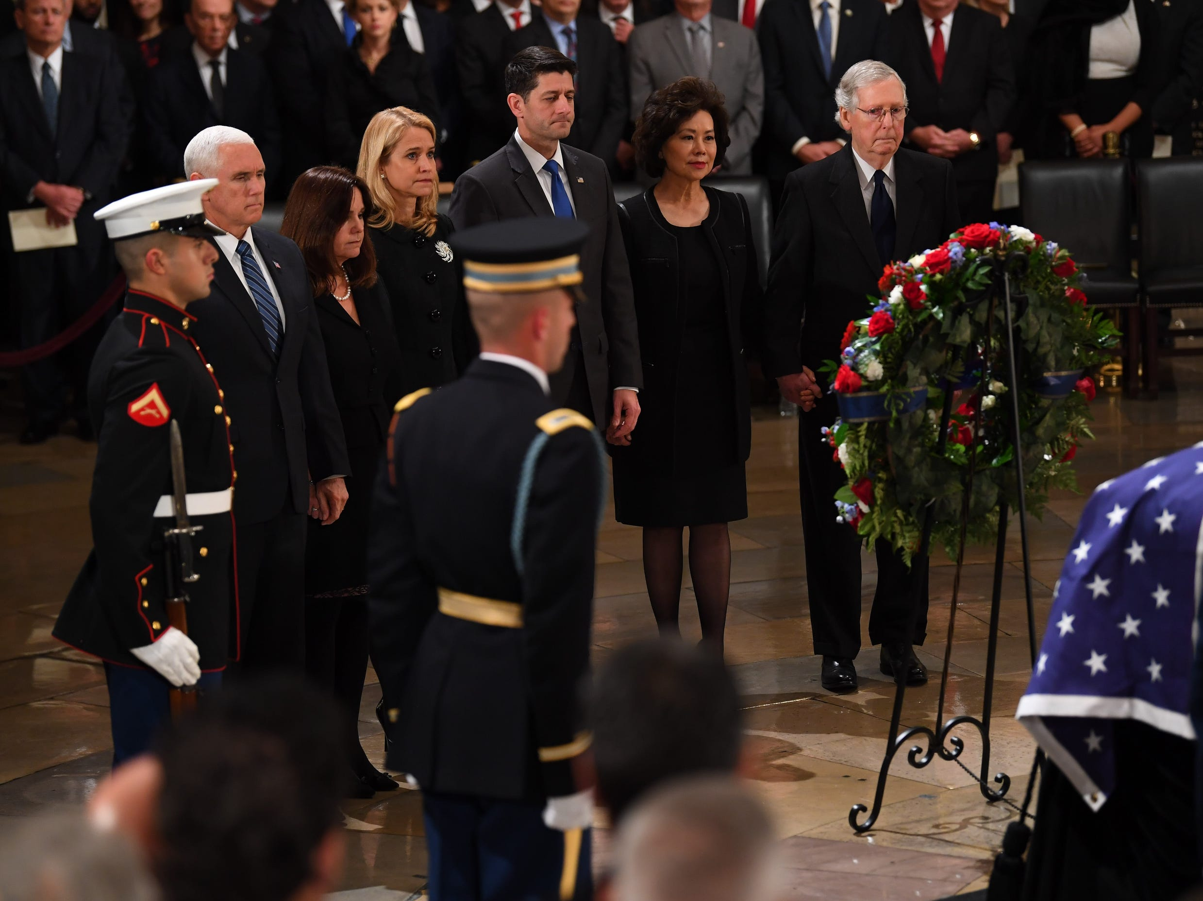 Top- ranking Republicans Vice President Mike Pence, 2nd left, his wife Karen Pence, Janna Ryan, House Speaker Paul Ryan, Sec. of Transportation Elaine Chow and  Senate Majority Leader Mitch McConnell pay their respects to the late President George H.W. Bush who lies in state at the U.S. Capitol Rotunda.