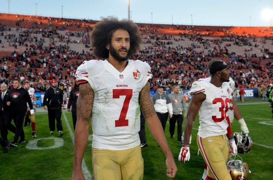 San Francisco 49ers quarterback Colin Kaepernick (7) reacts following the 22-21 victory against the Los Angeles Rams at Los Angeles Memorial Coliseum.