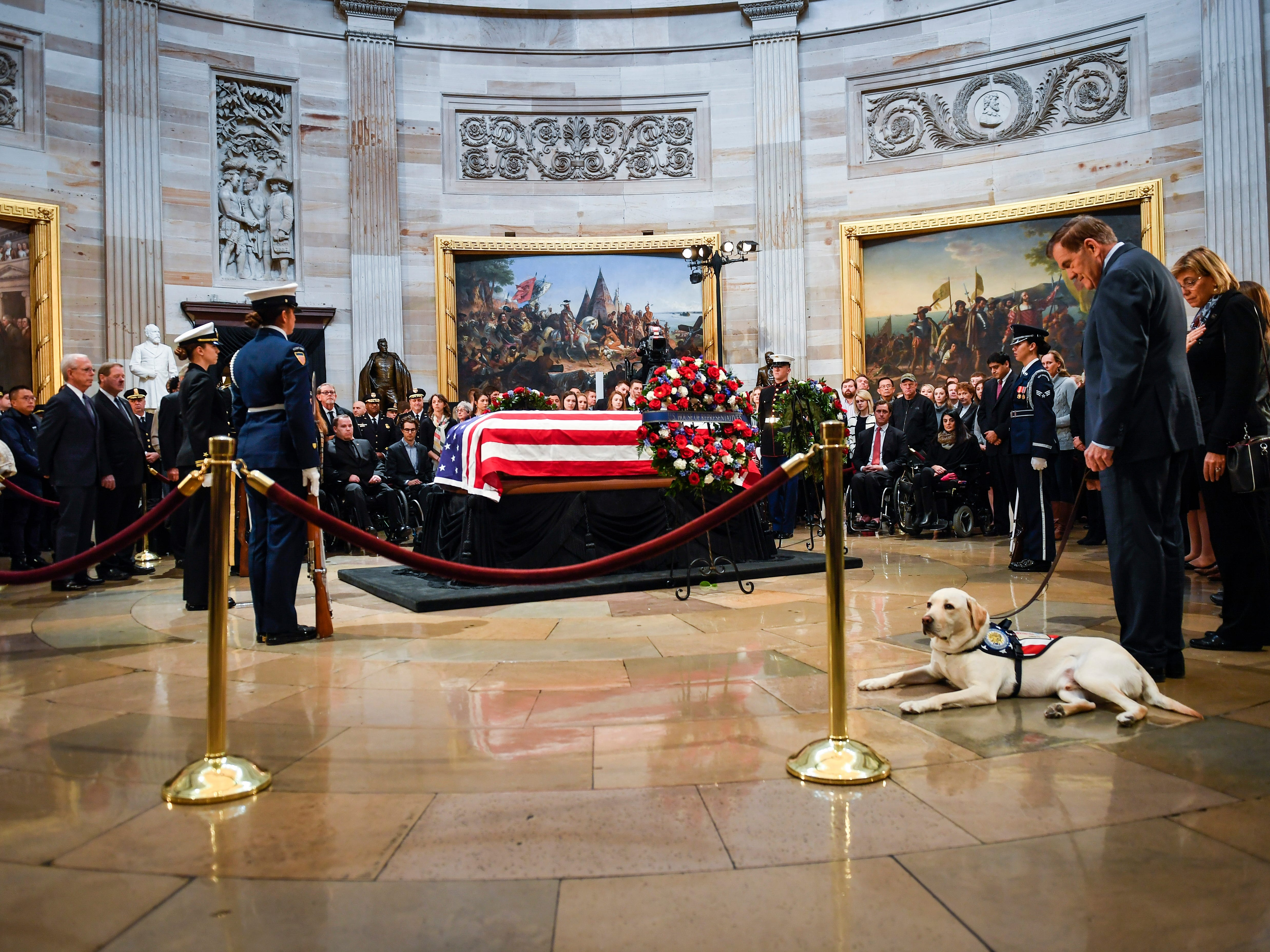 12/4/18 11:09:41 AM -- Washington, DC, U.S.A  -- George H.W. Bush's service dog Sully with former United States Secretary of Homeland Security Tom Ridge at the U.S. Capitol to honor late president. Sully, a service dog trained by America's VetDogs, will join Walter Reed National Military Medical Center's Facility Dog Program after the holidays. President George H.W. Bush lies in state at the U.S. Capitol Rotunda. --    Photo by Jack Gruber, USA TODAY staff ORG XMIT:  JG 137685 Arrival and Fune 12/4 (Via OlyDrop)