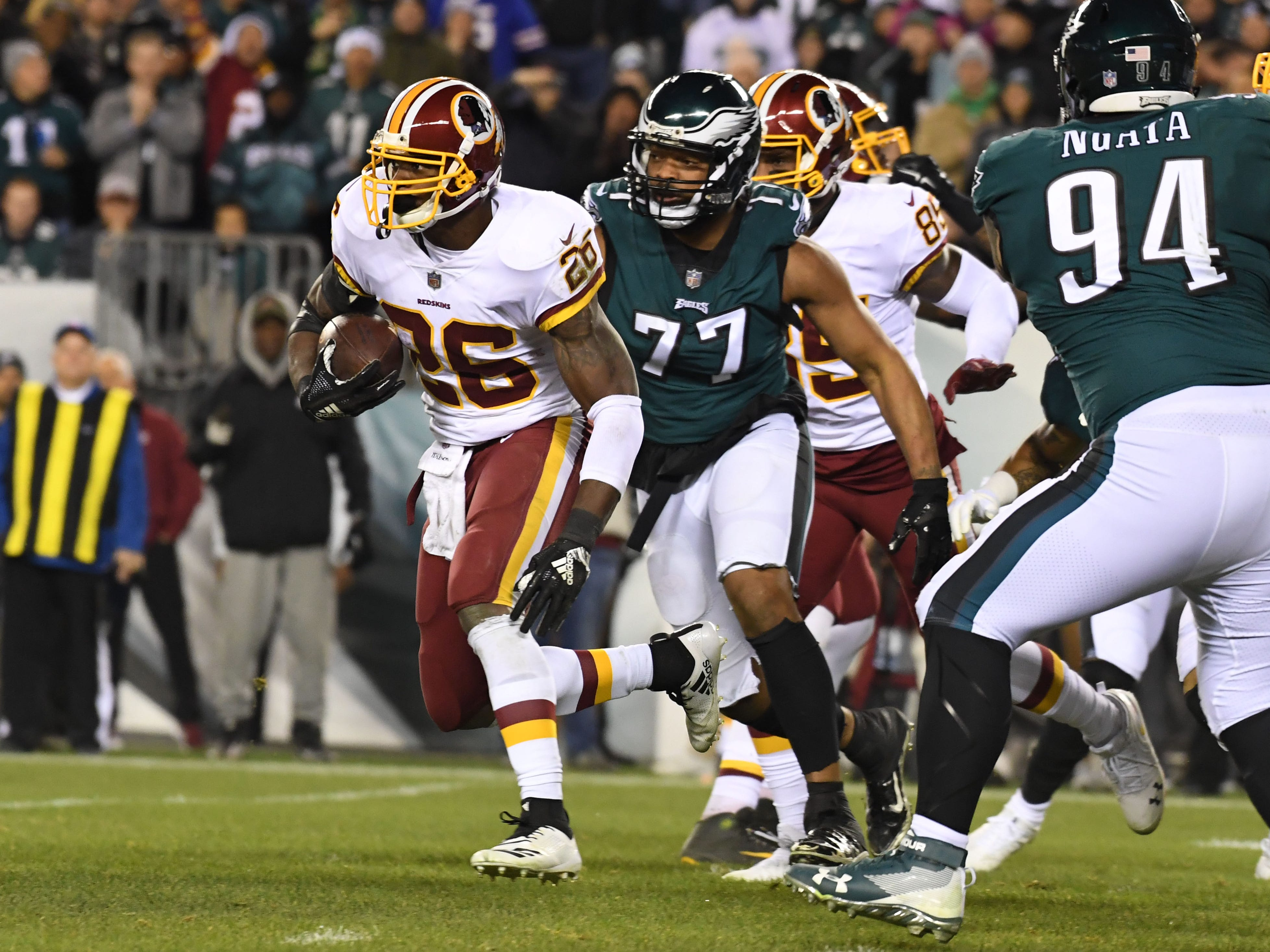Washington Redskins running back Adrian Peterson carries the ball en route to scoring a touchdown against the Philadelphia Eagles at Lincoln Financial Field.