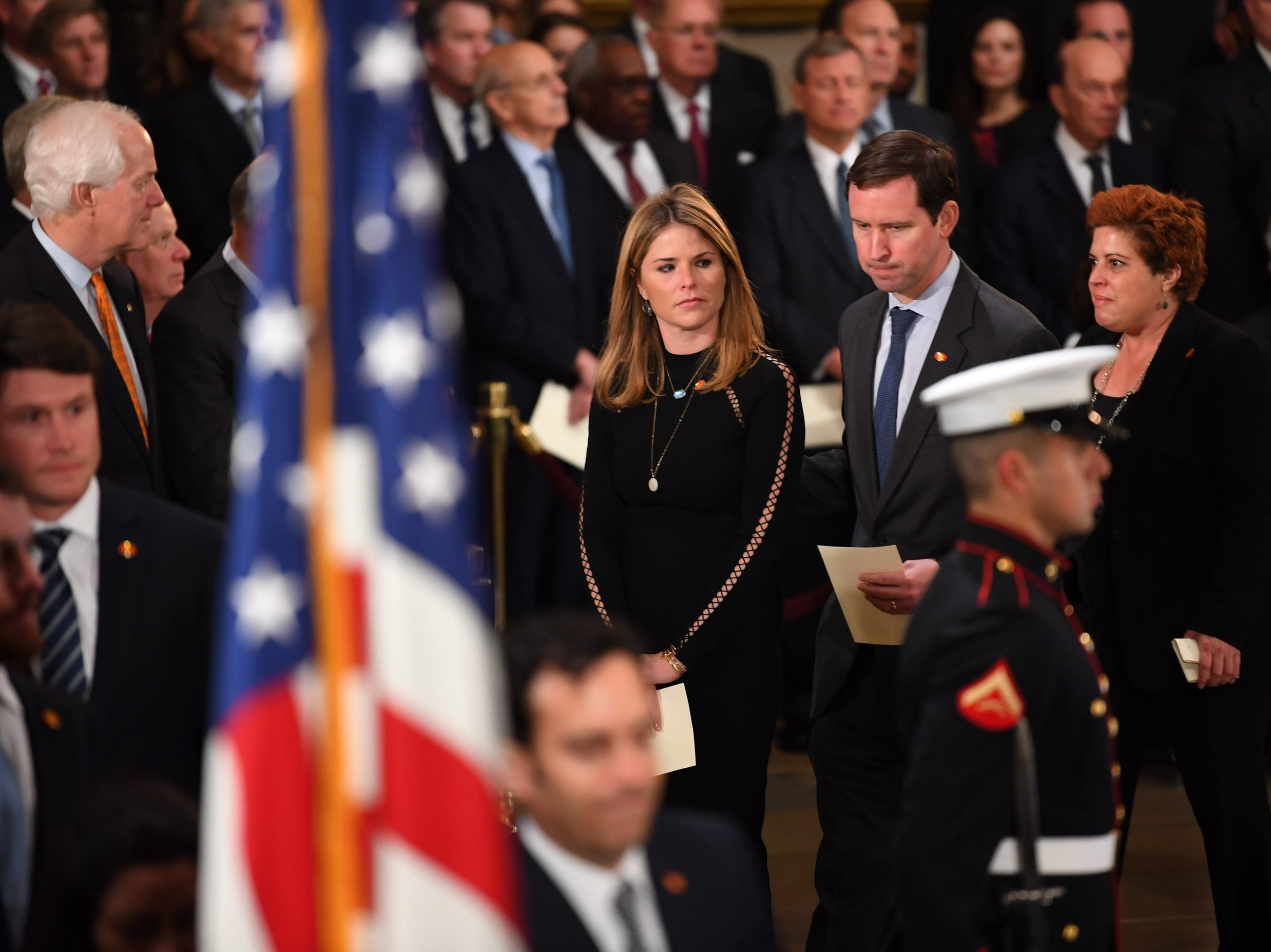 Jenna Bush Hager, center, her husband Henry Chase Hager and Noelle Bush walk past the casket of former President George H.W. Bush's, Monday.