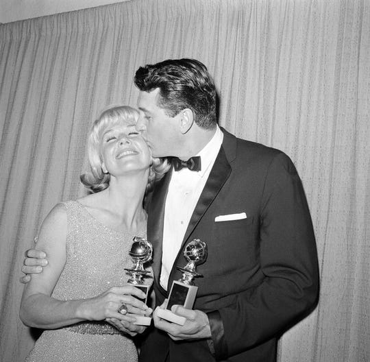 Actor Rock Hudson with Doris Day in Hollywood, March 6, 1963 after they were named world film favorites at the  Golden Globes that year.