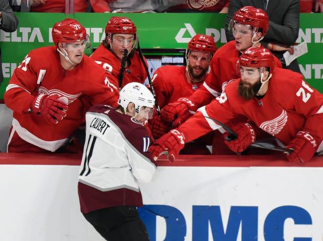 Detroit Red Wings players push away Colorado Avalanche left wing Matt Calvert after Calvert got his stick held during the third period.