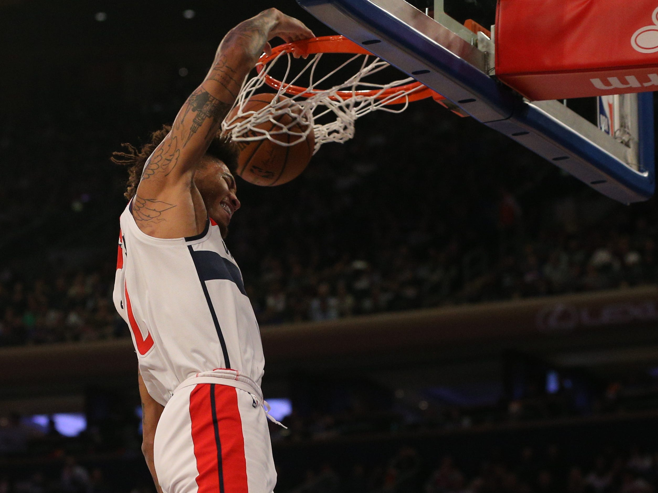 Dec. 3: Kelly Oubre Jr. dunks against the Knicks during the second quarter at Madison Square Garden.