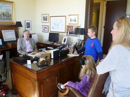 Trevor Roth (blue shirt) interviewing George H.W. Bush in Houston, Texas.