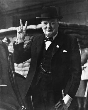 "British Prime Minister Winston Churchill gives a ""Victory Salute"" on Aug. 27, 1941."