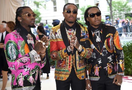 Quavo, from left, Offset and Takeoff, of Migos, attend The Metropolitan Museum of Art's Costume Institute benefit gala celebrating the opening of the Heavenly Bodies: Fashion and the Catholic Imagination exhibition on Monday, May 7, 2018, in New York. (Photo by Evan Agostini/Invision/AP) ORG XMIT: NYAH526