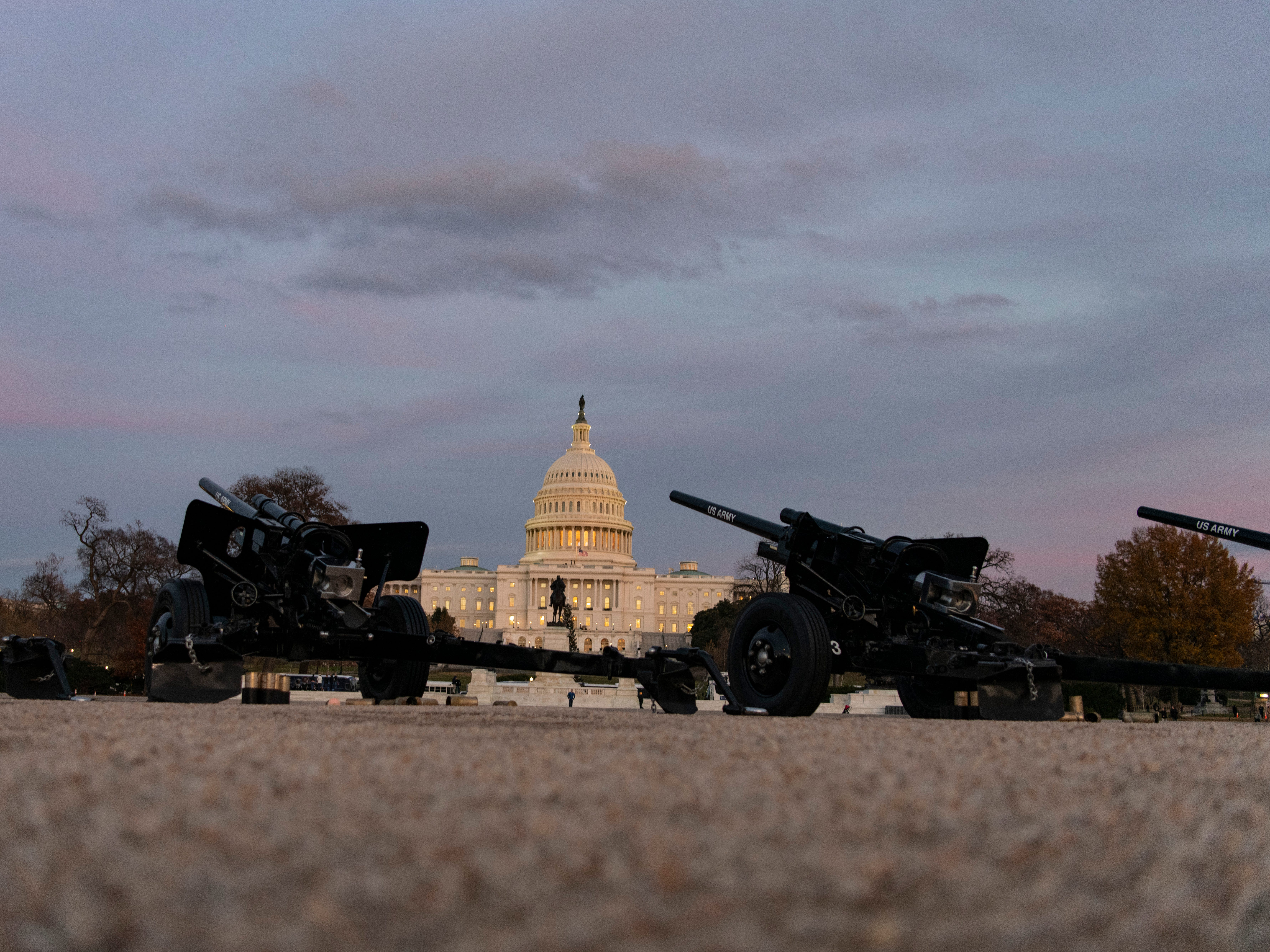 The Presidential Salute Battery marks the arrival of President George H. W. Bush's casket at the U.S. Capitol with a 21-gun salute by canons used in WWII.