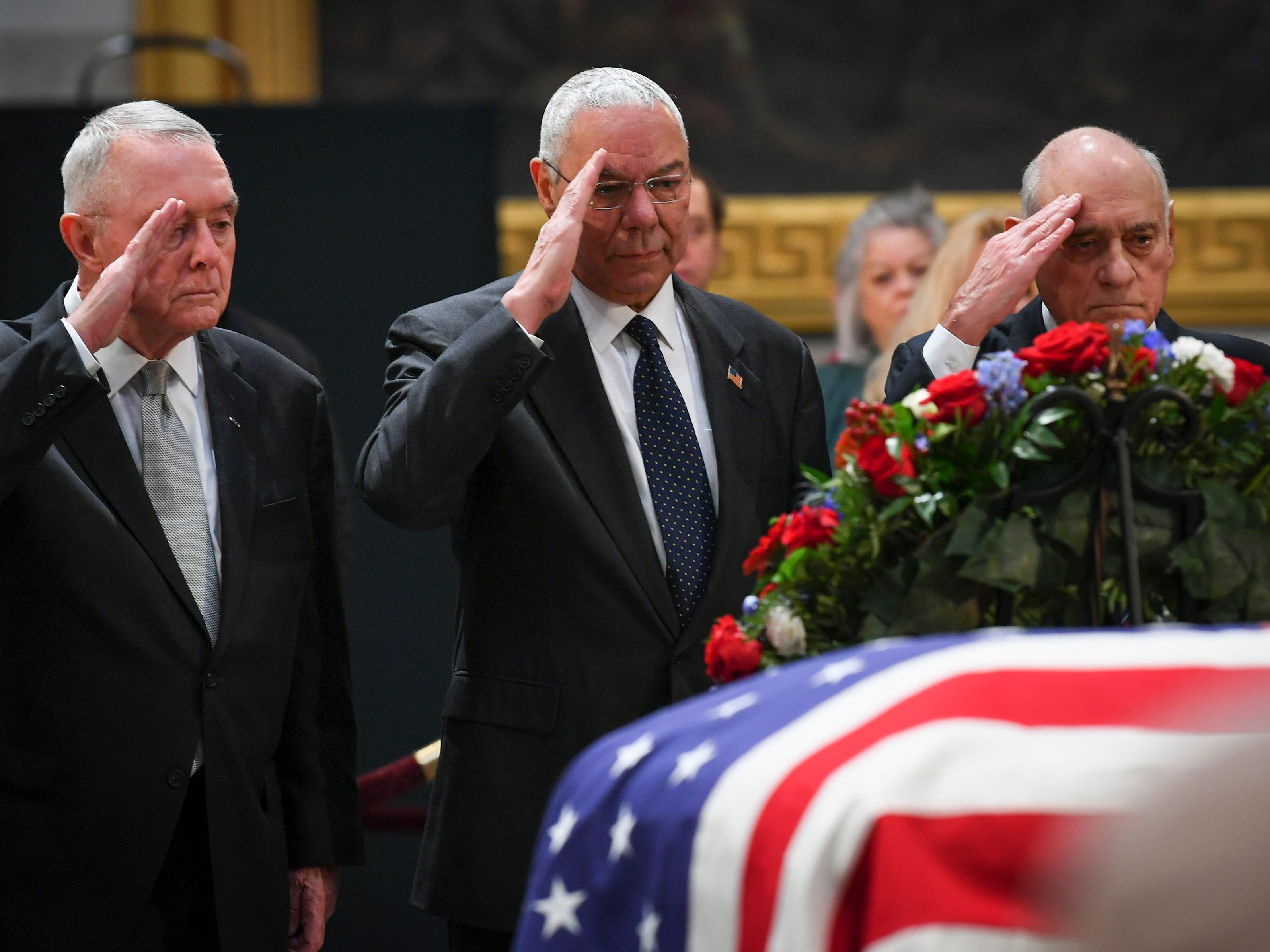 12/4/18 10:31:45 AM -- Washington, DC, U.S.A  -- Colin Powell, the 65th United States Secretary of State (2001-2005), who served under President George W. Bush, center, pays respect to President Bush as he lies in state at the U.S. Capitol Rotunda. --    Photo by Jack Gruber, USA TODAY staff ORG XMIT:  JG 137685 Arrival and Fune 12/4 (Via OlyDrop)