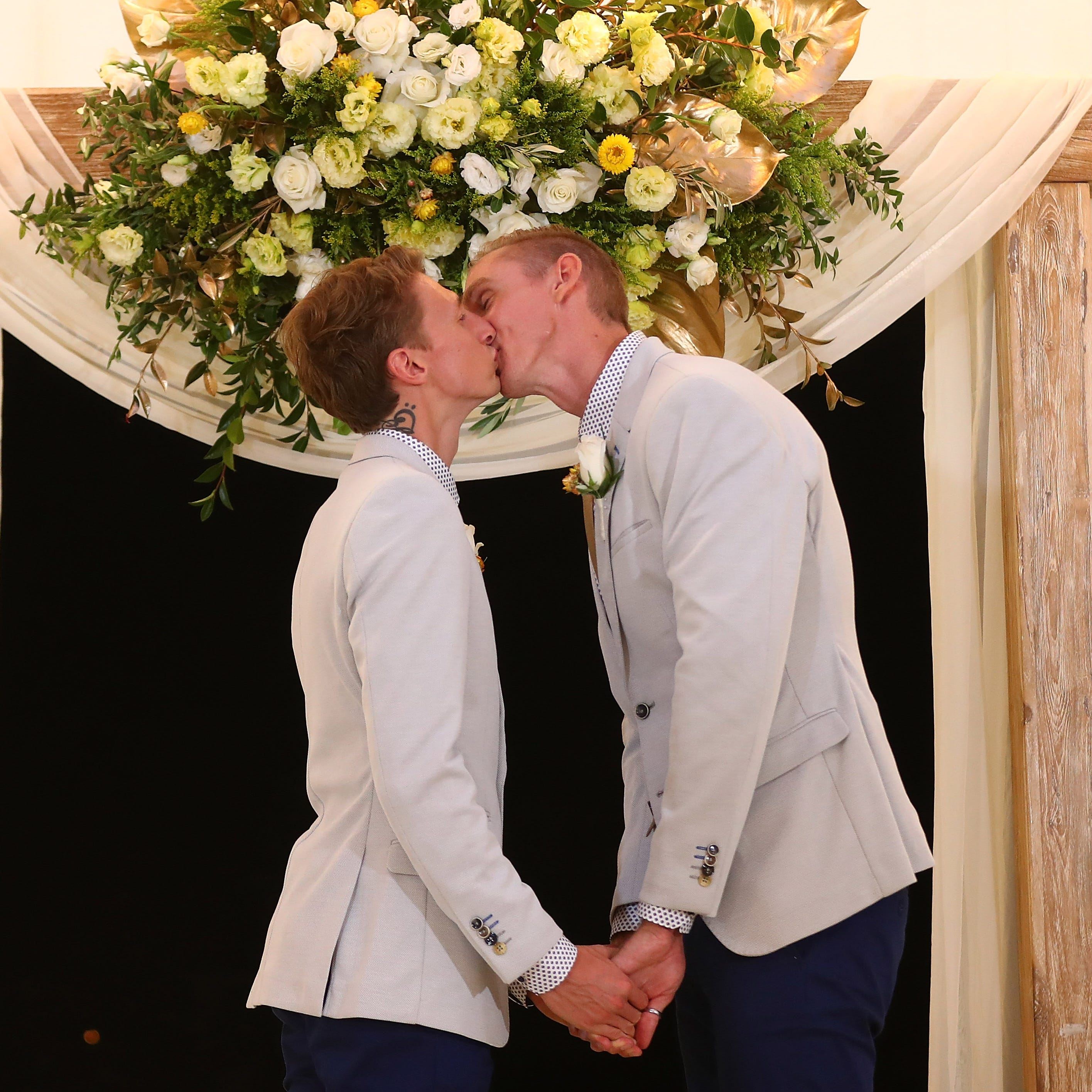 Craig Burns and Luke Sullivan kiss during the wedding ceremony after  Australian Marriage Act became legal