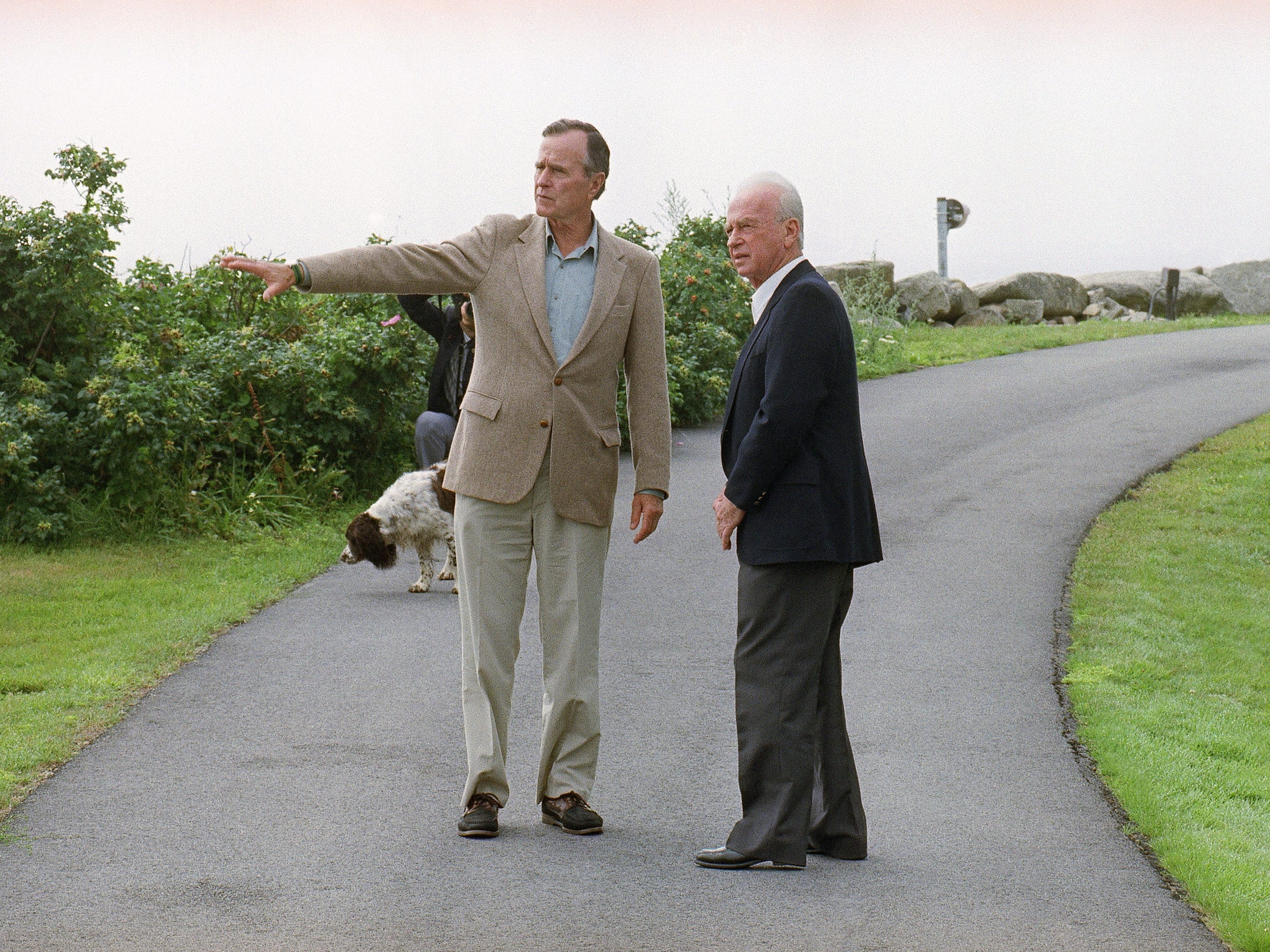 President George H W Bush, left, points something out to Prime Minister Yitzhak Rabin of Israel as they walk on the grounds on August 11, 1992 at Bush's vacation home in Kennebunkport, Maine. (AP Photo/Greg Gibson)