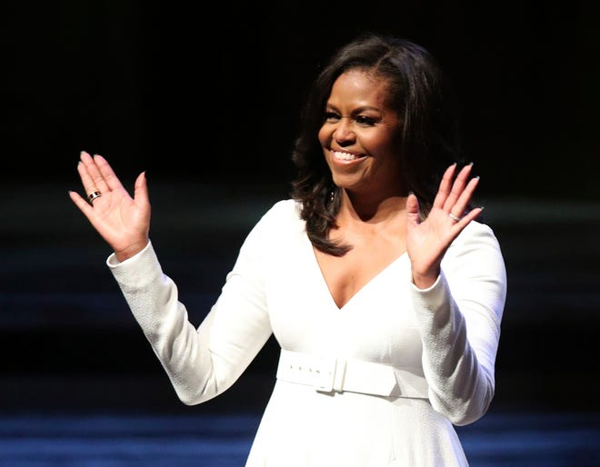 Michelle Obama acknowledges the crowd during her visit to Britain for her book tour at the Royal Festival Hall in London, Dec. 3, 2018.