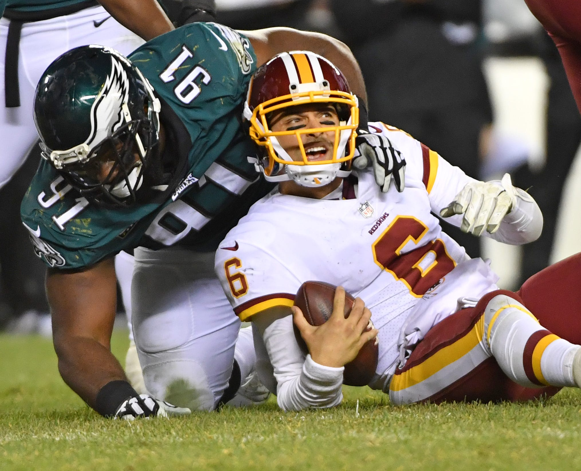 Philadelphia Eagles defensive tackle Fletcher Cox (91) sacks Washington Redskins quarterback Mark Sanchez (6) during the fourth quarter at Lincoln Financial Field.