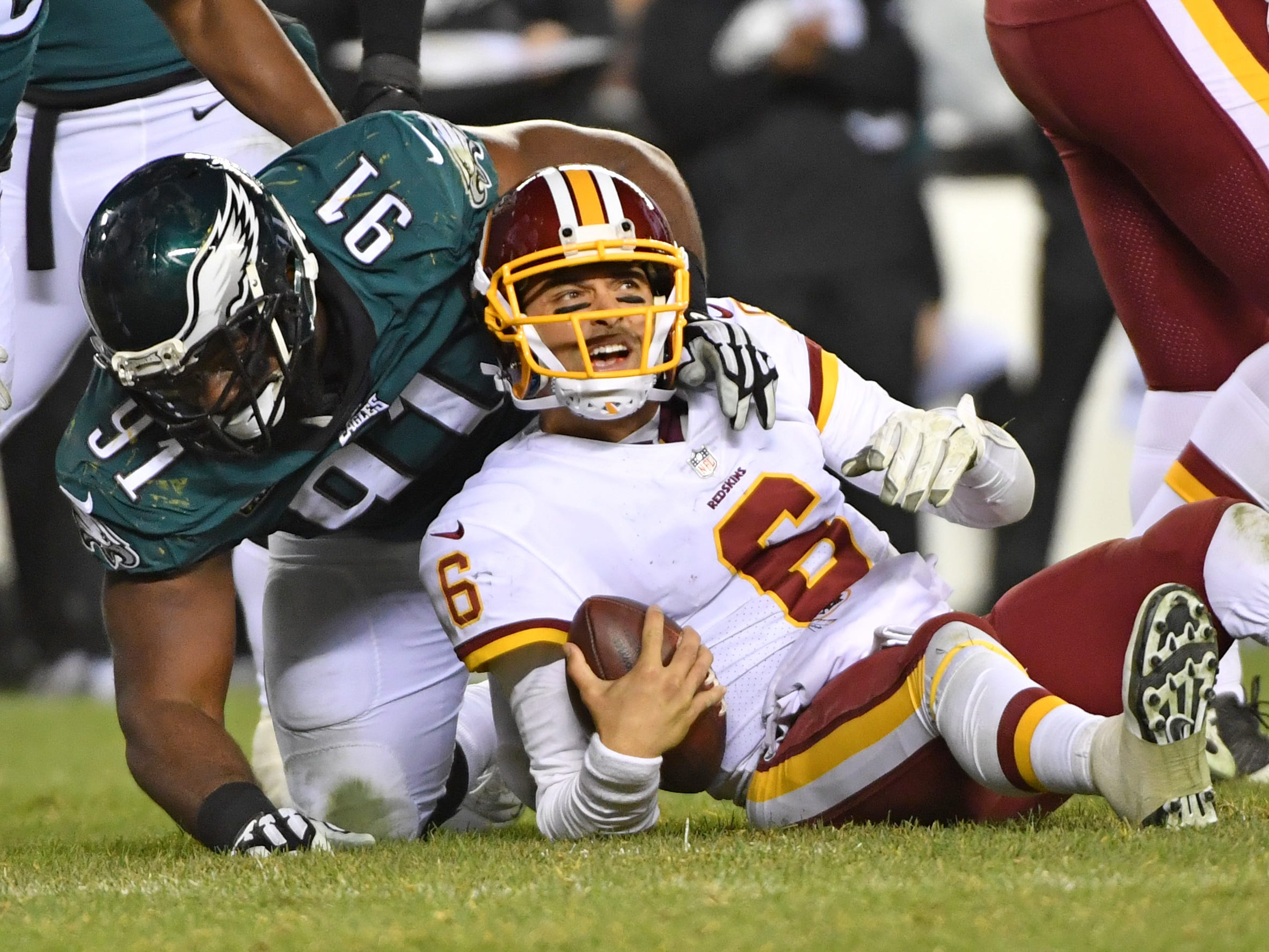 Philadelphia Eagles defensive tackle Fletcher Cox (91) sacks Washington Redskins quarterback Mark Sanchez (6) during the fourth quarter at Lincoln Financial Field.