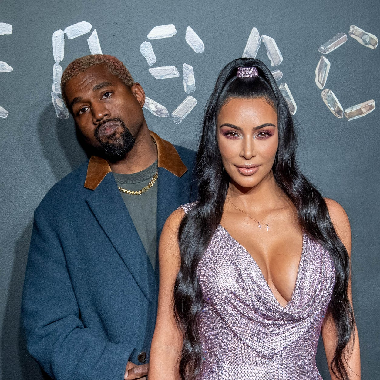 Kanye West and Kim Kardashian West step out to attend the the Versace fall 2019 fashion show at the American Stock Exchange Building in lower Manhattan.