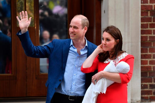Prince William and Duchess Kate of Cambridge show off Prince Louis, their newly-born son and third child, to the media outside St Mary's Hospital in London, on April 23, 2018.