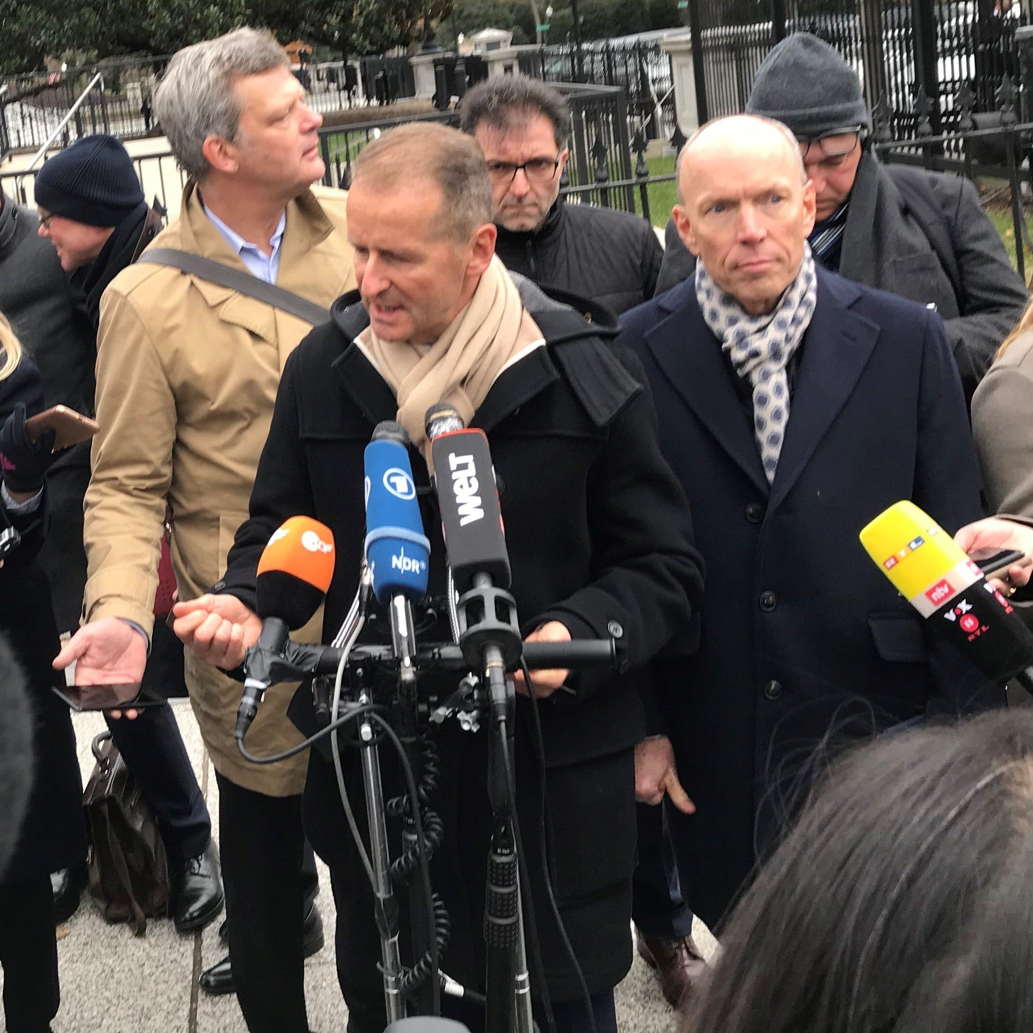 Volkswagen CEO Herbert Diess addresses the media outside the White House.