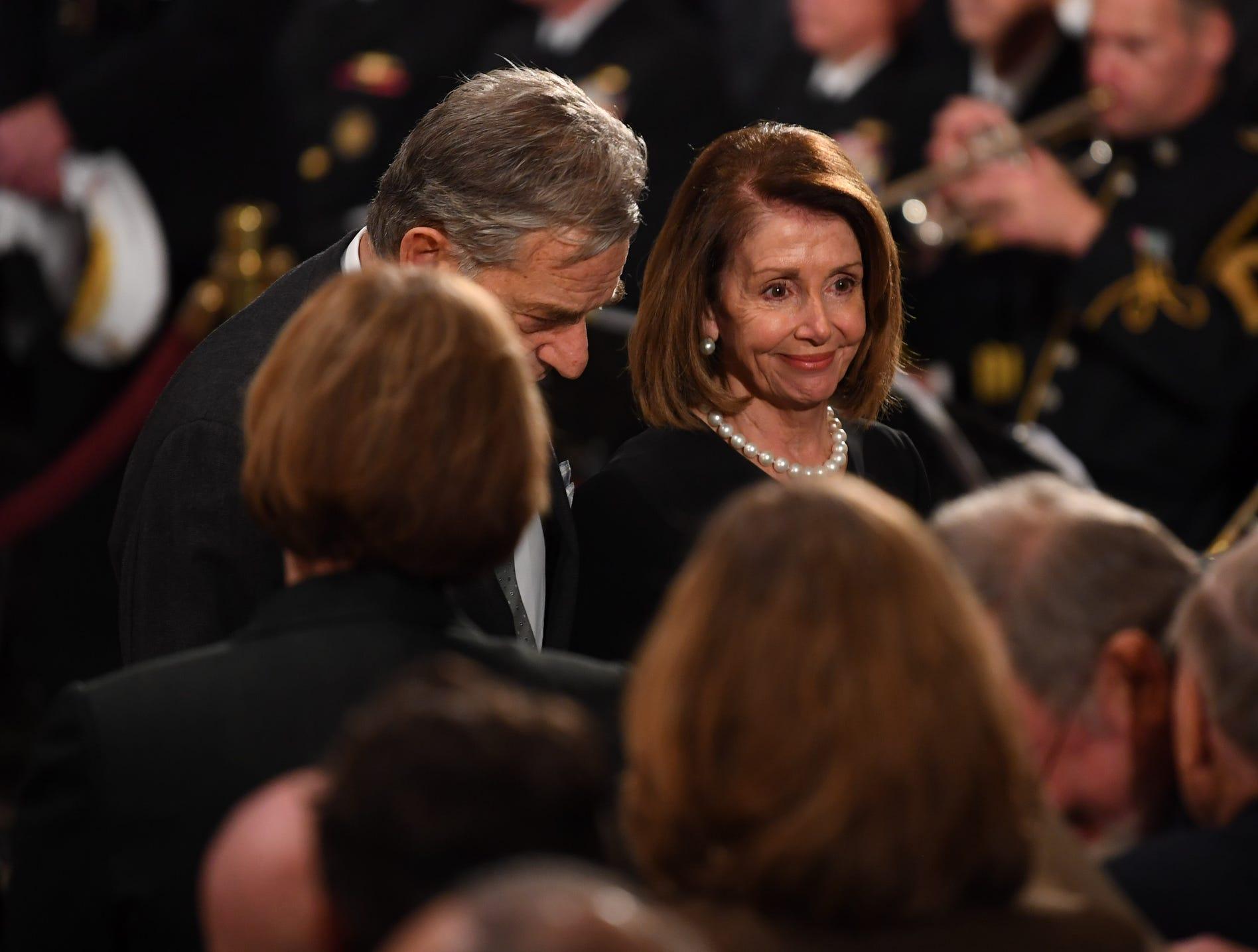 U.S. House Minority Leader Rep. Nancy Pelosi (D-CA)  smiles at the Capitol Rotunda service for the President George H.W. Bush.