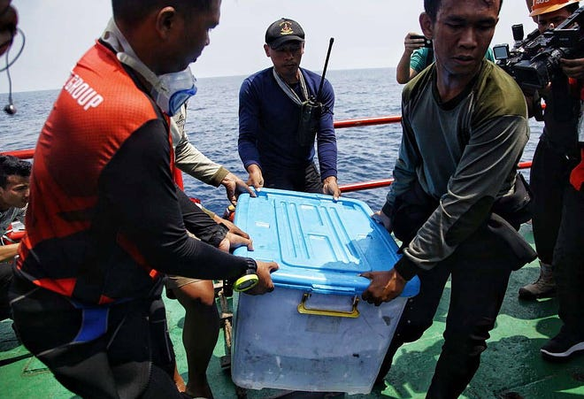 Indonesians recover a plastic box containing the data recorder of Lion Air Flight 610 on Nov. 1, 2018.