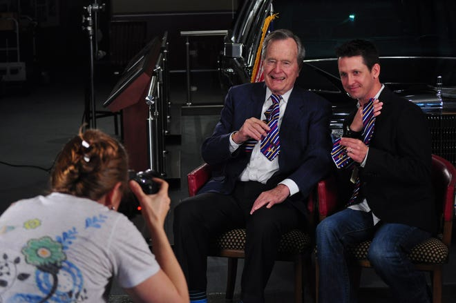 George H.W. Bush and Jeffrey Roth showing off the ties that Bush had made for the film.