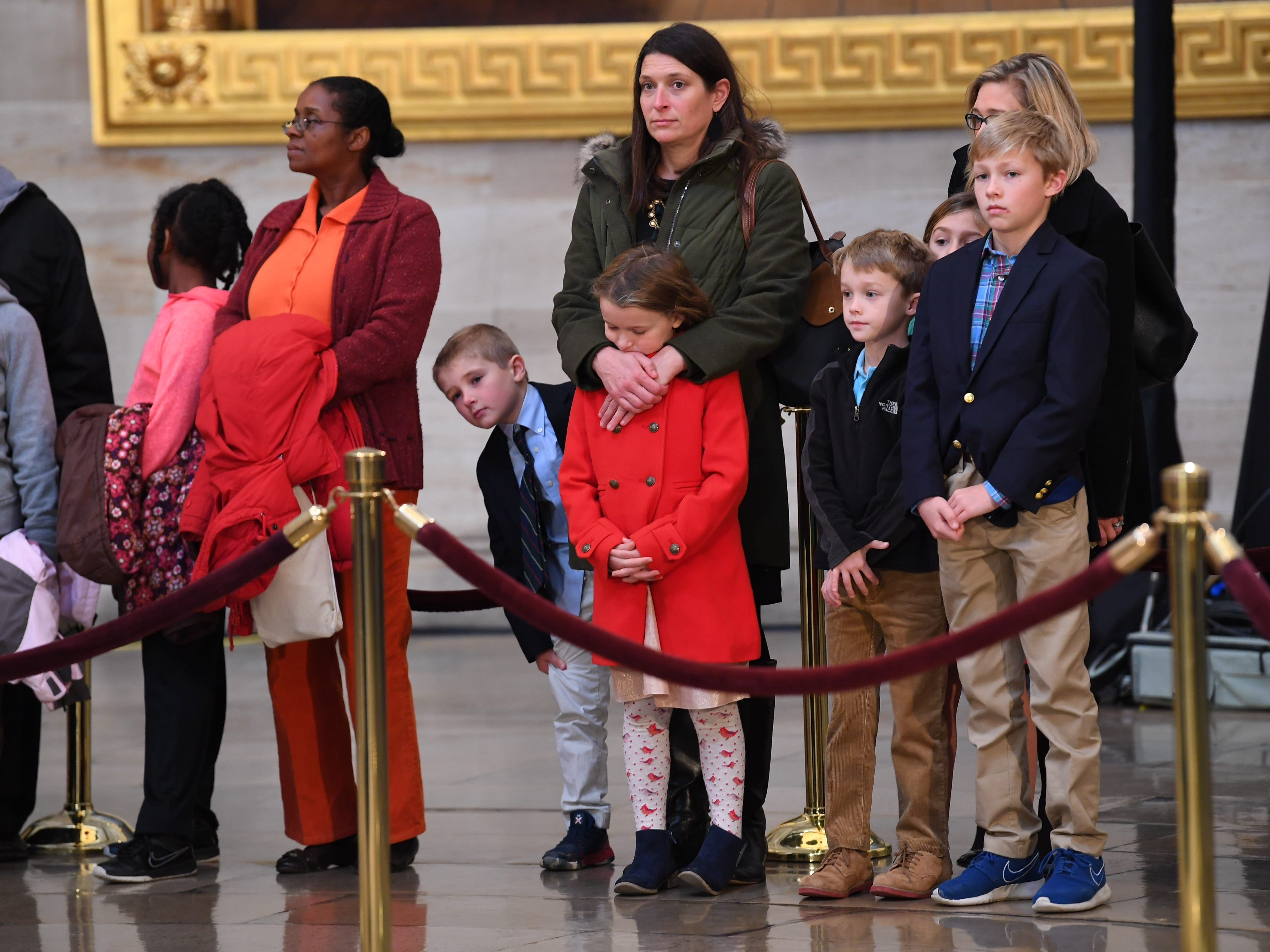 12/4/18 9:10:54 AM -- Washington, DC, U.S.A  -- Visitors to the Capitol Rotunda pay respects to President George H.W. Bush as he lies in state at the U.S. Capitol Rotunda. --    Photo by Jack Gruber, USA TODAY staff ORG XMIT:  JG 137685 Arrival and Fune 12/4/2018 (Via OlyDrop)