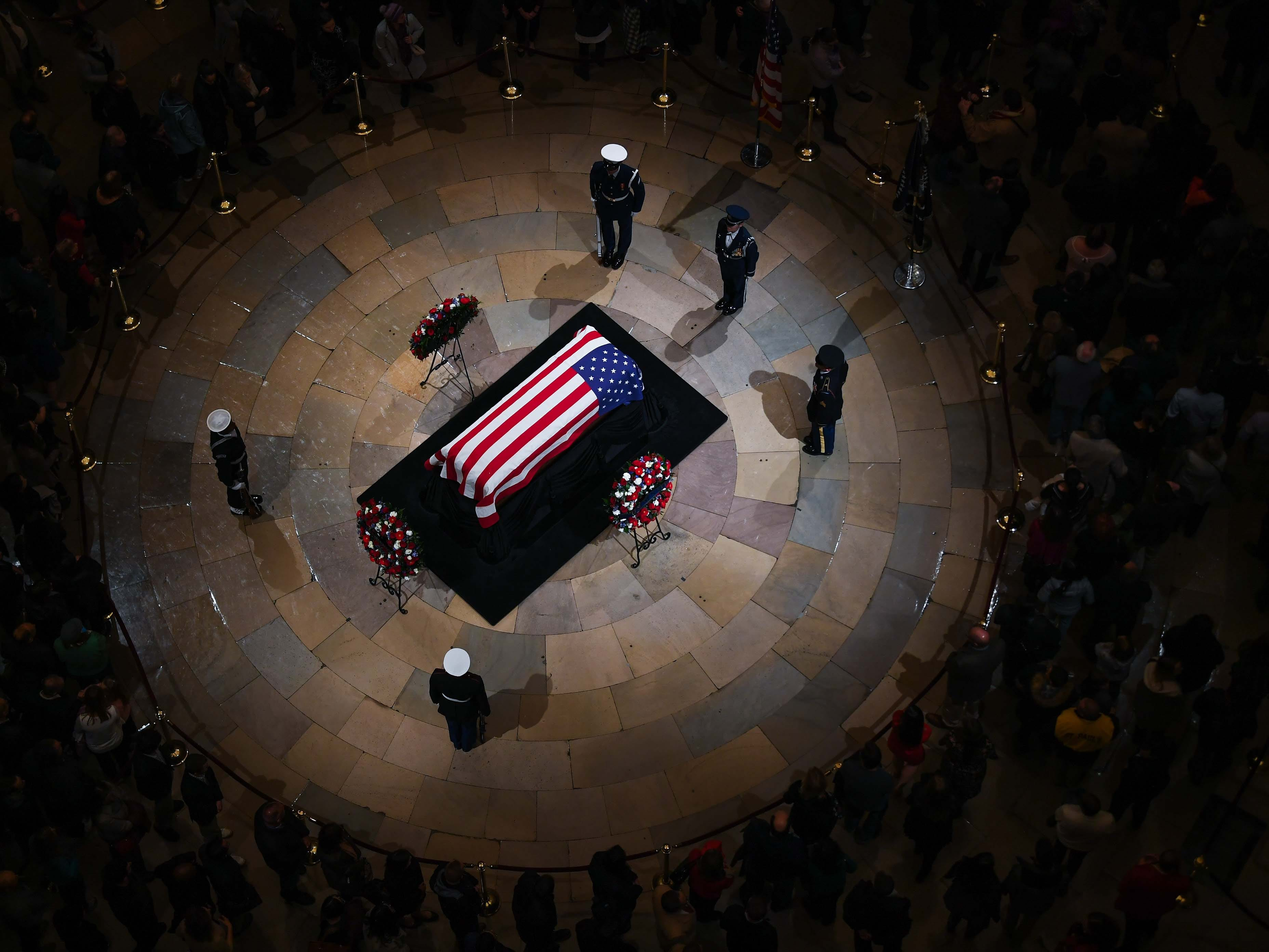 President George H.W. Bush lies in state at the U.S. Capitol Rotunda.