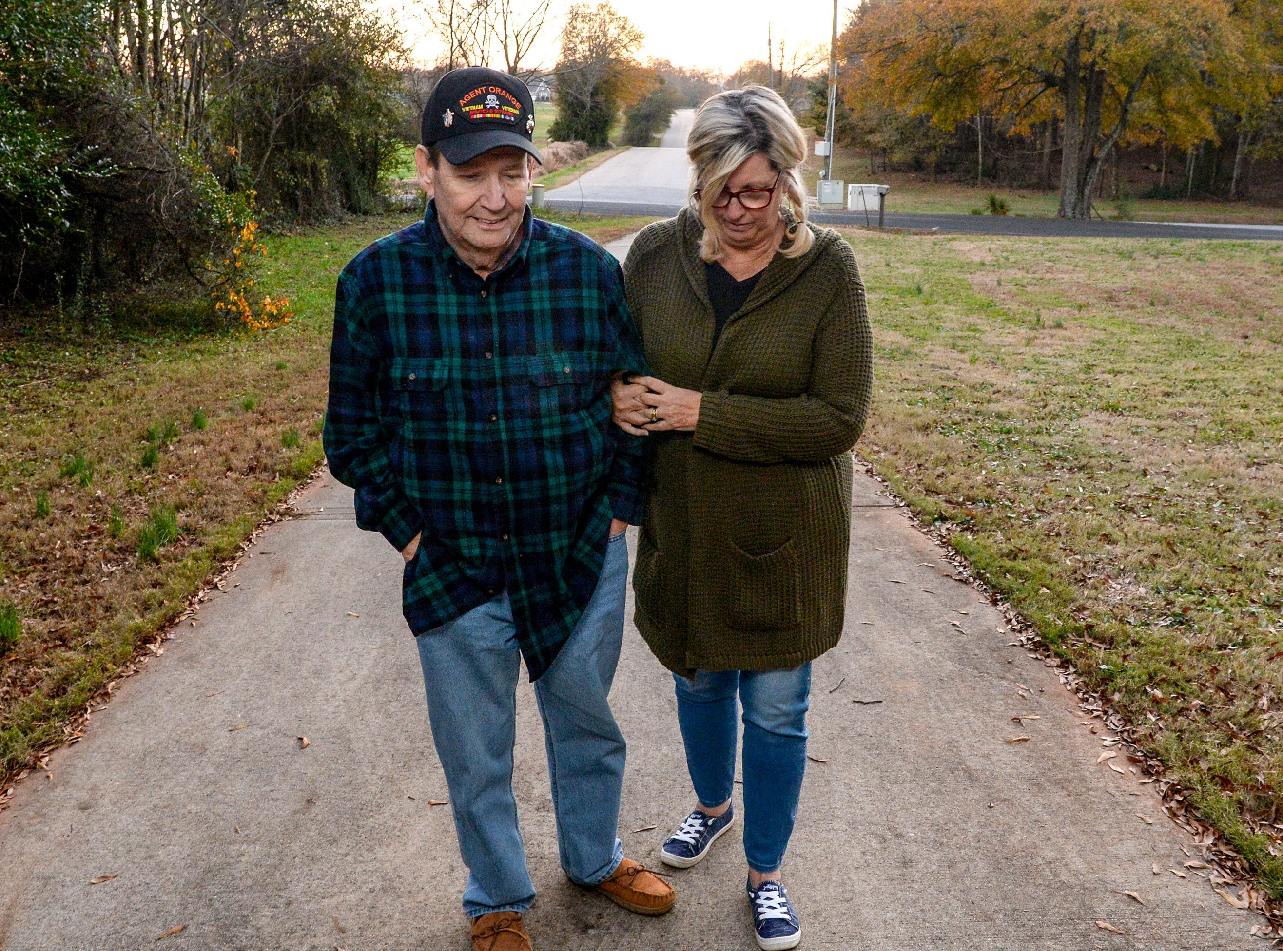 Vietnam Veteran Billy Konrad, left, and Bonnie Konrad walk up their driveway at their home West of Anderson in December. Konrad served in the U.S. Marine Corps from 1966 to 1968 and says he deals with the hardships of health after his time serving.