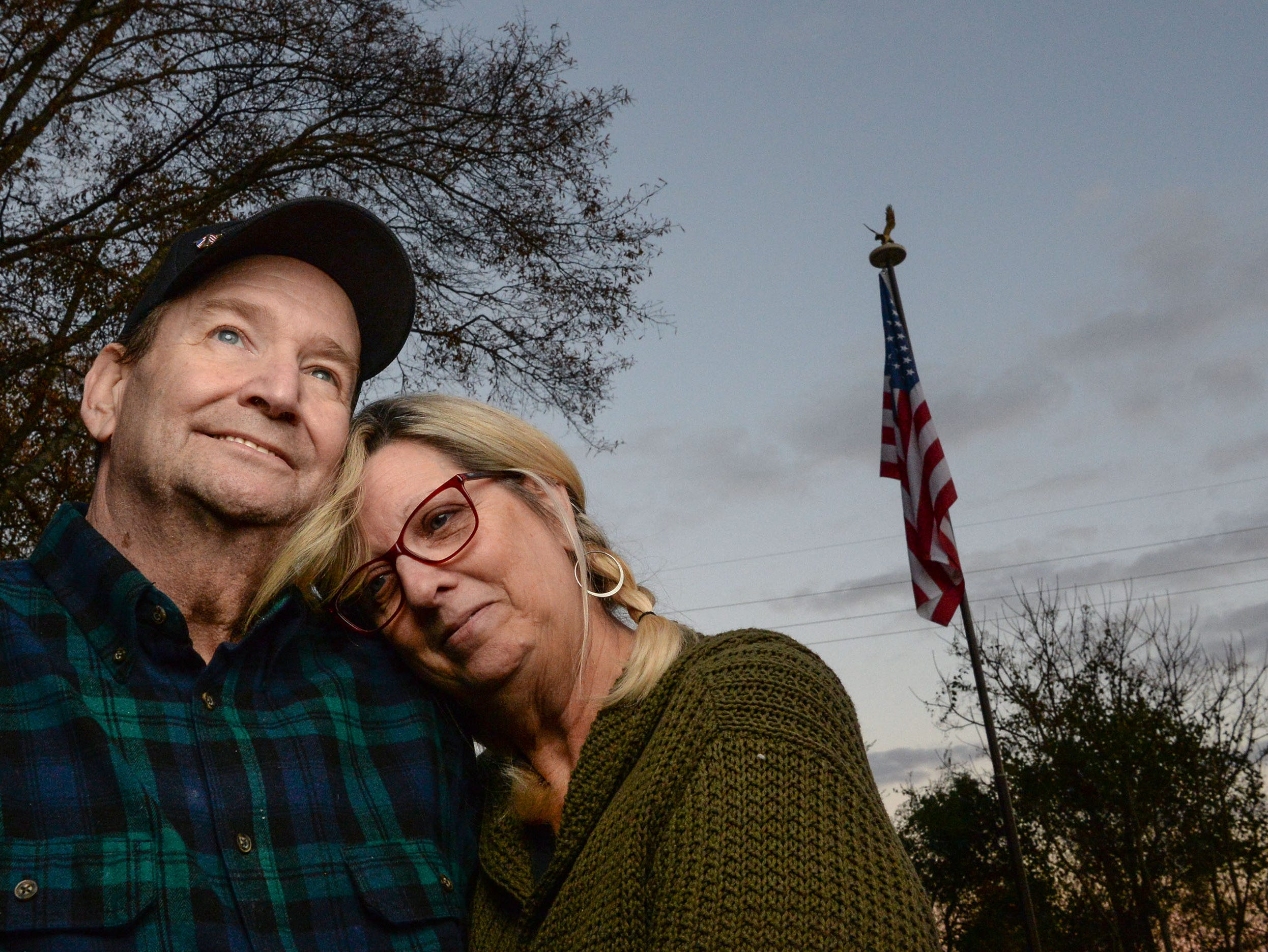 Vietnam Veteran Billy Konrad, left, Bonnie Konrad in their front yard looking at the sunset sky over the West side of Anderson in December. Konrad served in the U.S. Marine Corps from 1966 to 1968 and says he deals with the hardships of health after his time serving.