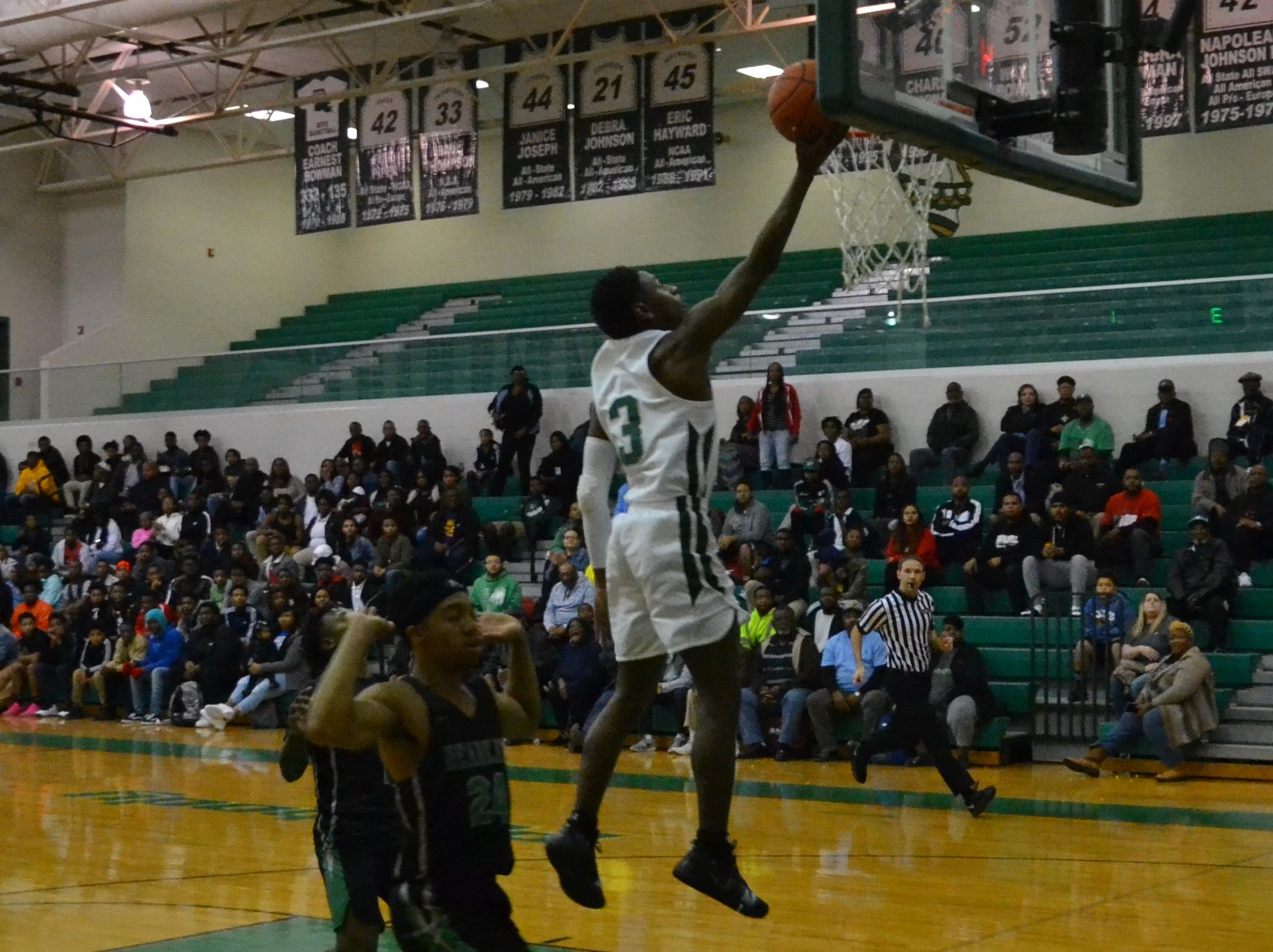 Peabody's Melvion Flanagan (3) get the layup for the Warhorses. The Peabody boys basketball team played the Bossier Bearkats Tuesday night at the Emerald Palace. Peabody got the win 72-67.