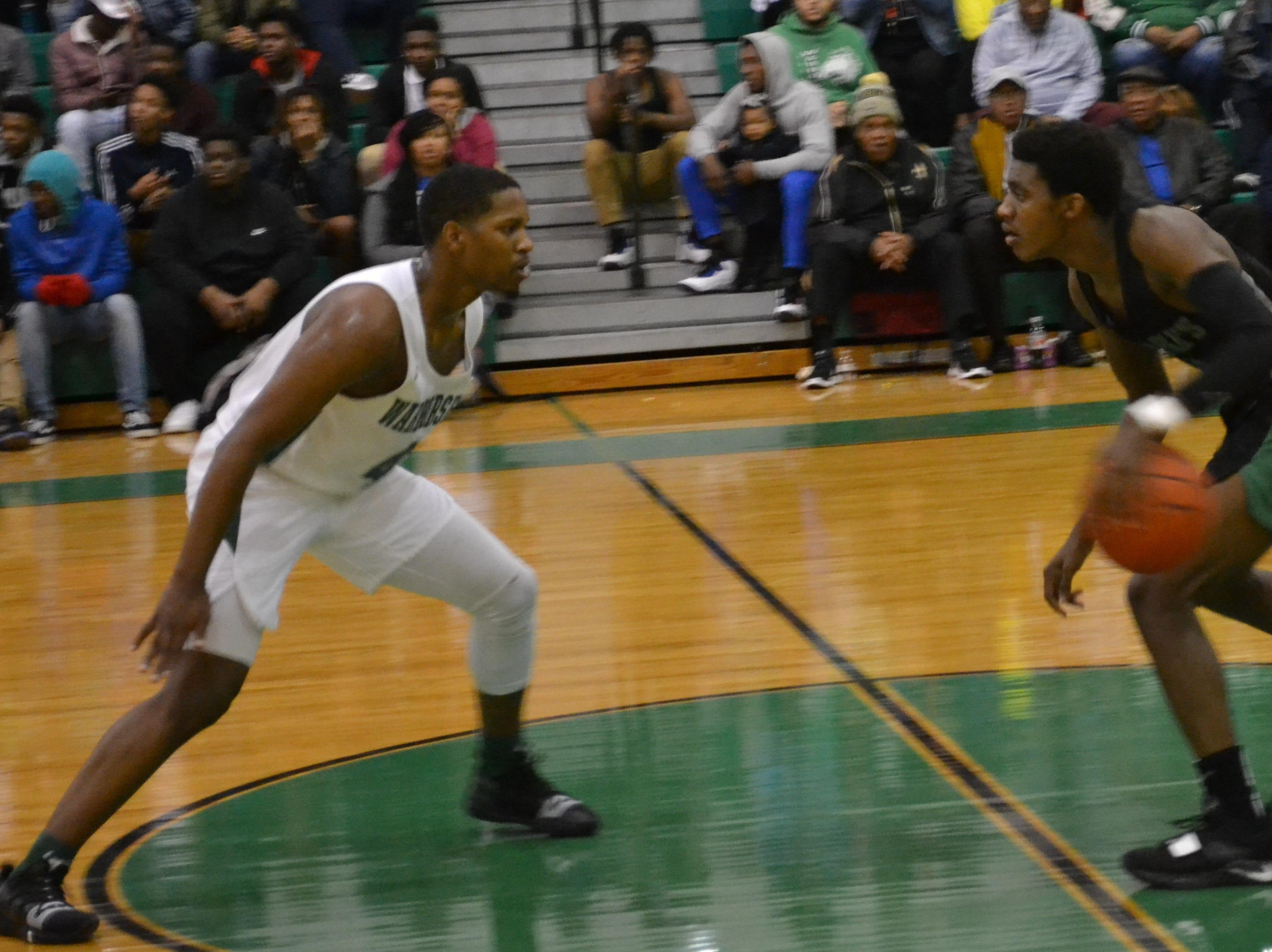 Peabody's Kyron Gibson (4) (left) defends Bossier's Kaalas Roots. The Peabody boys basketball team played the Bossier Bearkats Tuesday night at the Emerald Palace. Peabody got the win 72-67.