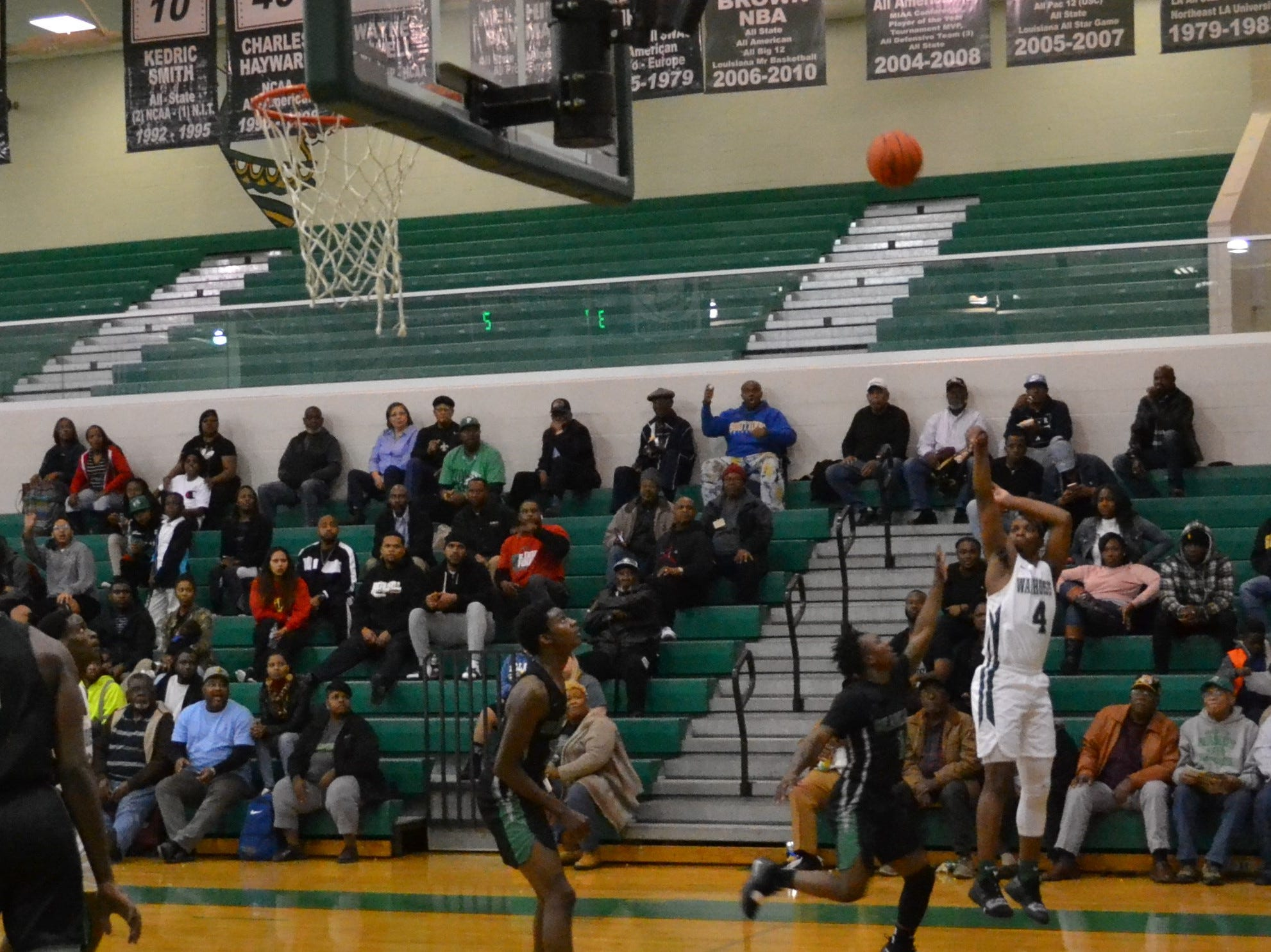 Kyron Gibson (4) launches a 3-point shot from the corner. The Peabody boys basketball team played the Bossier Bearkats Tuesday night at the Emerald Palace. Peabody got the win 72-67.