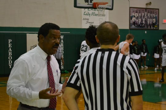 Peabody head coach Charles Smith pleads his case with the referee concerning foul calls. The Peabody boys basketball team played the Bossier Bearkats Tuesday night at the Emerald Palace. Peabody got the win 72-67.