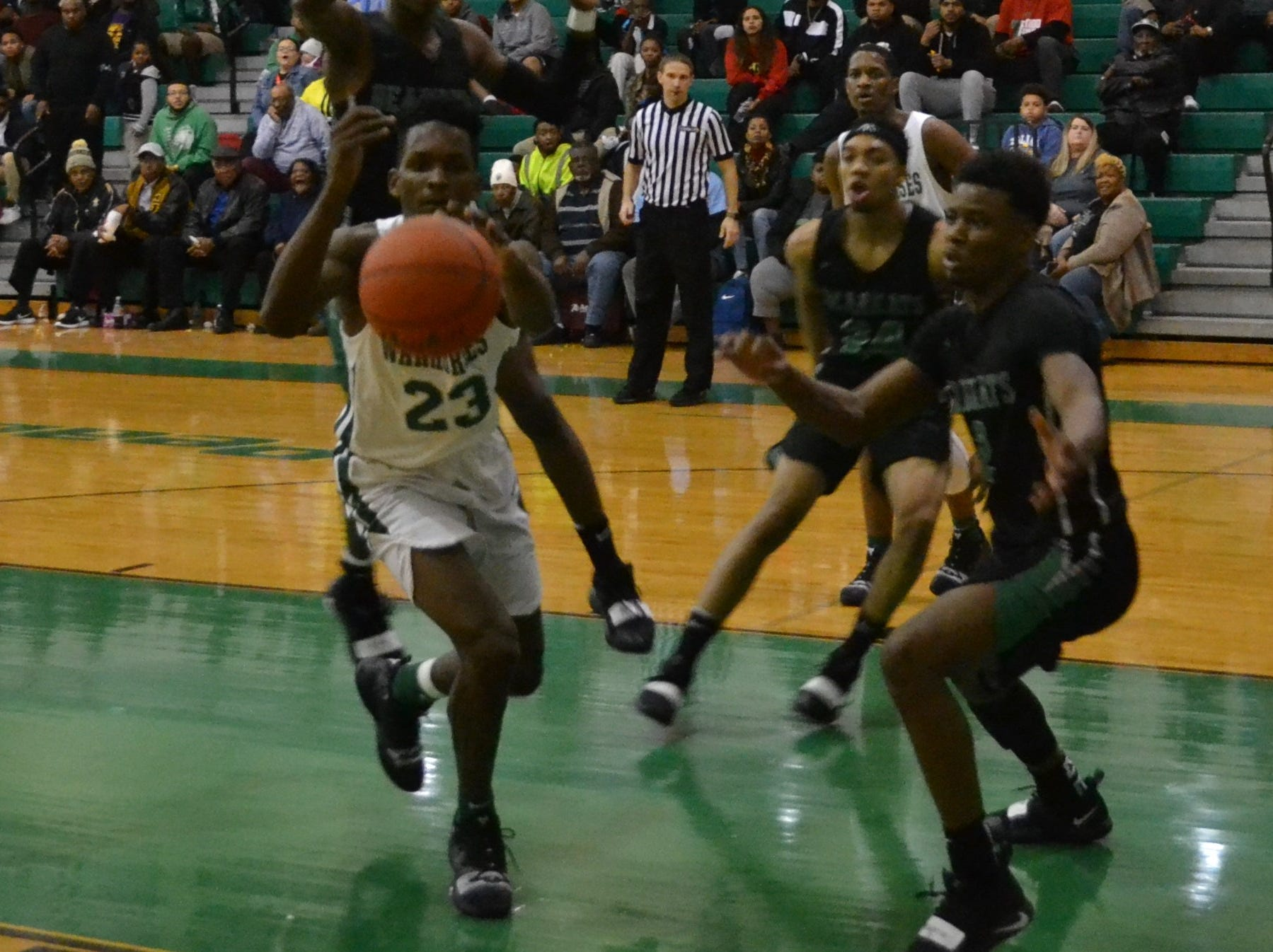 Peabody's Darius Smith (23) tracks down a loose ball. The Peabody boys basketball team played the Bossier Bearkats Tuesday night at the Emerald Palace. Peabody got the win 72-67.