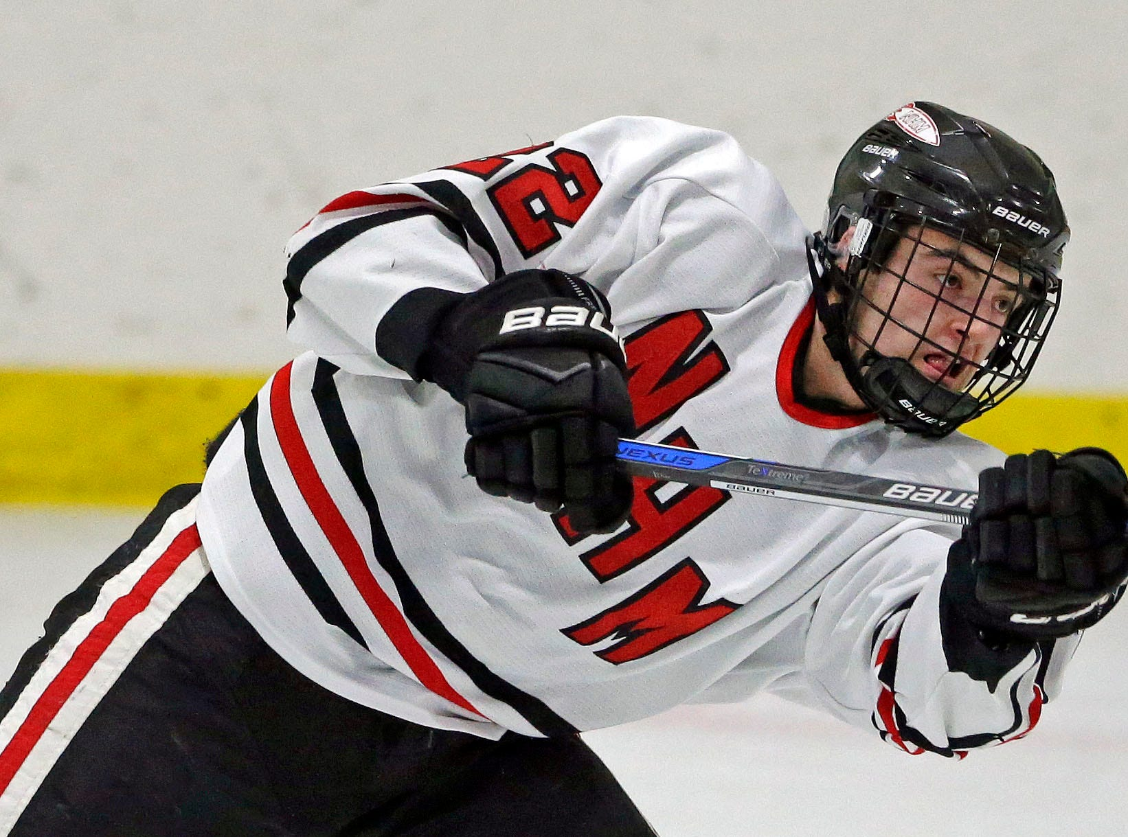 Mason Marquardt of Neenah/Hortonville/Menasha scores a goal against Oshkosh in a Badgerland Conference hockey game Tuesday, December 4, 2018, at Tri-County Ice Arena in Fox Crossing, Wis.Ron Page/USA TODAY NETWORK-Wisconsin