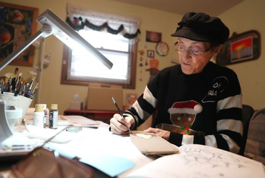 Artist Linda Hatton of Little Chute was one of the cancer patients transferred from Fox Valley Hematology & Oncology to ThedaCare. Here, she is shown working on a wall hanging in her home studio.