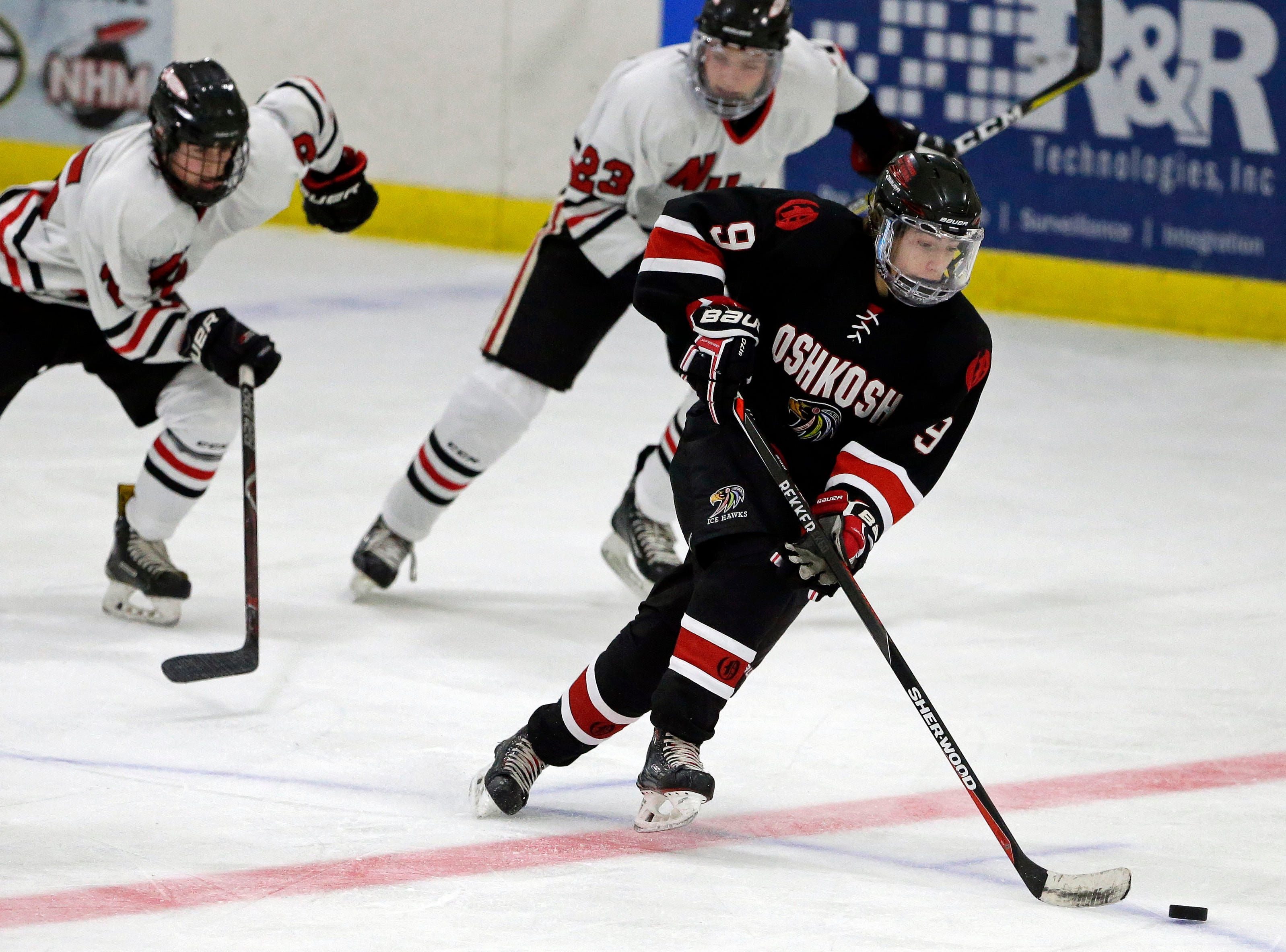 Mason Robertson of Oshkosh moves the puck against Neenah/Hortonville/Menasha in a Badgerland Conference hockey game Tuesday, December 4, 2018, at Tri-County Ice Arena in Fox Crossing, Wis.Ron Page/USA TODAY NETWORK-Wisconsin