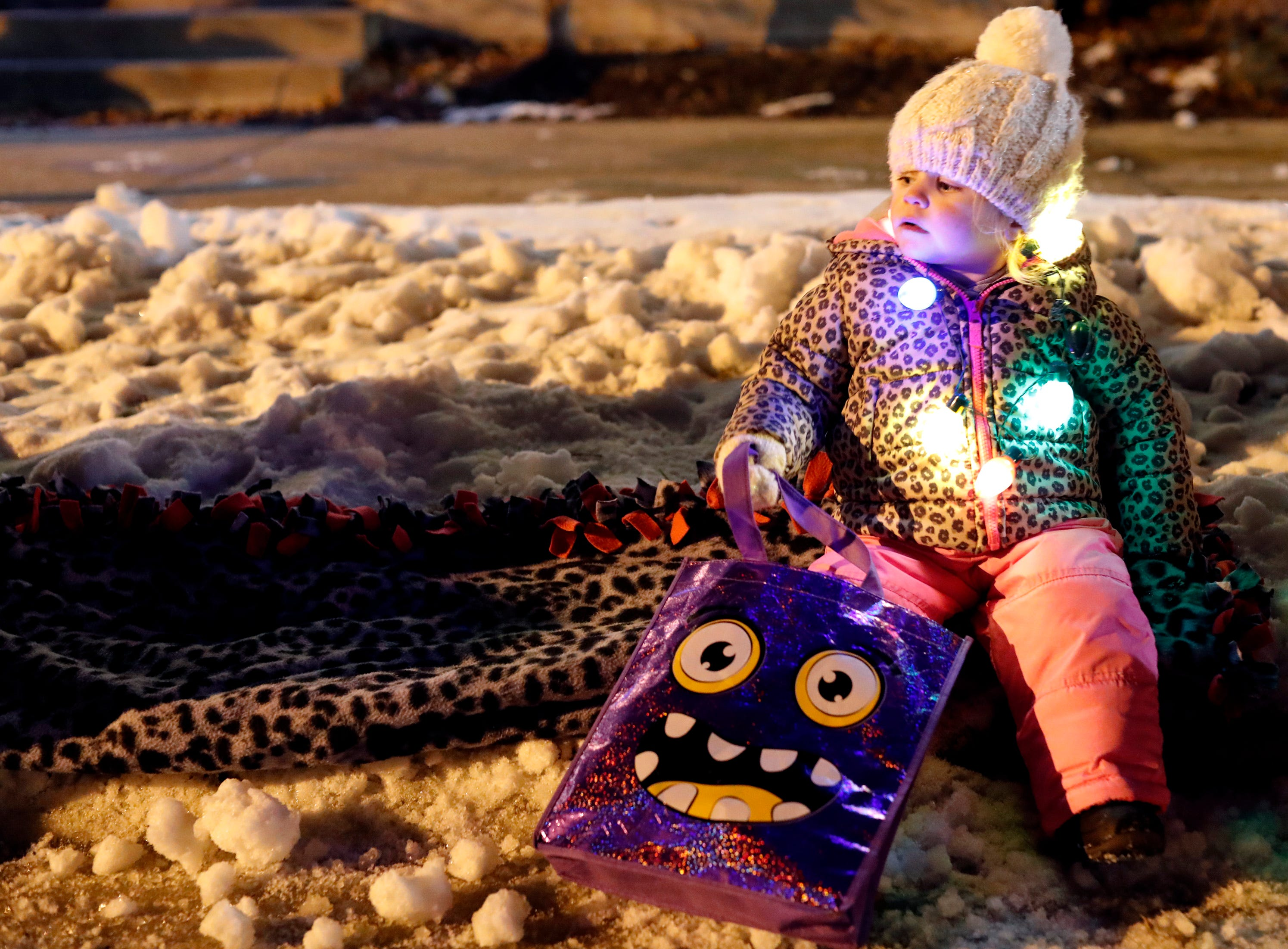 Lainey Weyenberg, 2, waits for the Electric City Christmas Parade to start Tuesday, Dec. 4, 2018, in Kaukauna, Wis.
