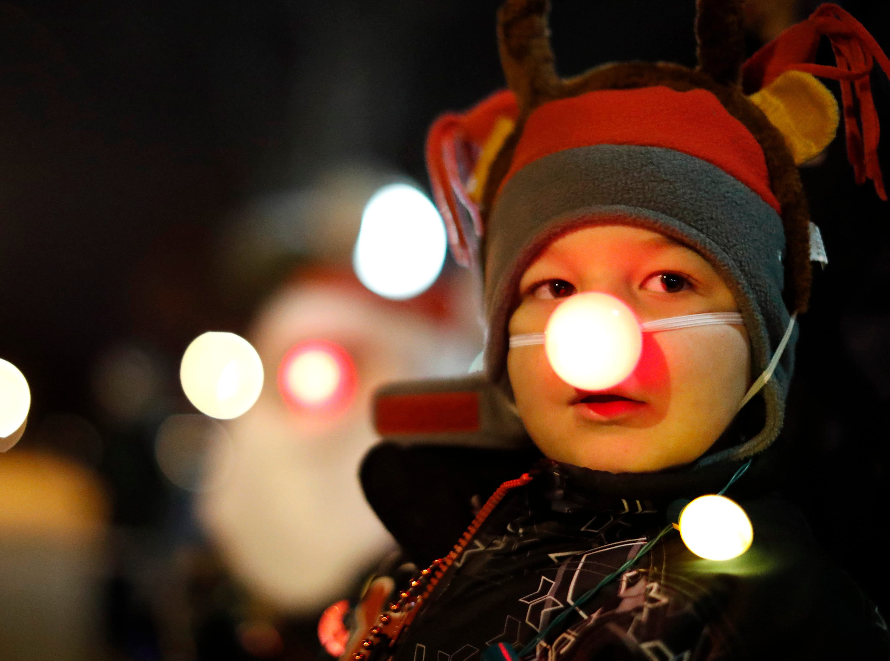 Camden Vandenberg, 5, is dressed as Rudolph the Red Nosed Reindeer while waiting for the Electric City Christmas Parade to start  Tuesday, Dec. 4, 2018, in Kaukauna, Wis.
