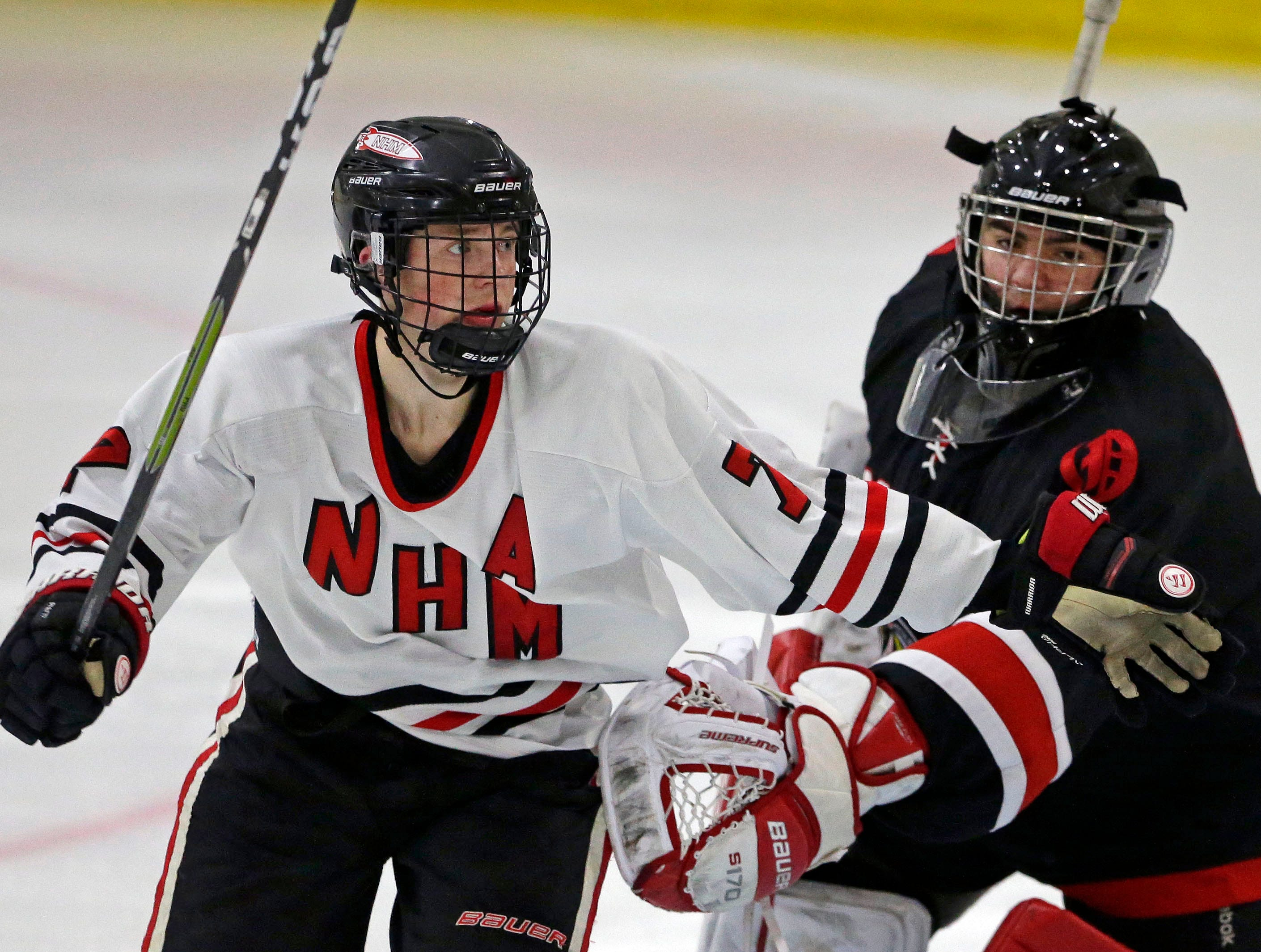 Ethan Long of Neenah/Hortonville/Menasha looks for the puck as he gets by Connor Klett of Oshkosh in a Badgerland Conference hockey game Tuesday, December 4, 2018, at Tri-County Ice Arena in Fox Crossing, Wis.Ron Page/USA TODAY NETWORK-Wisconsin