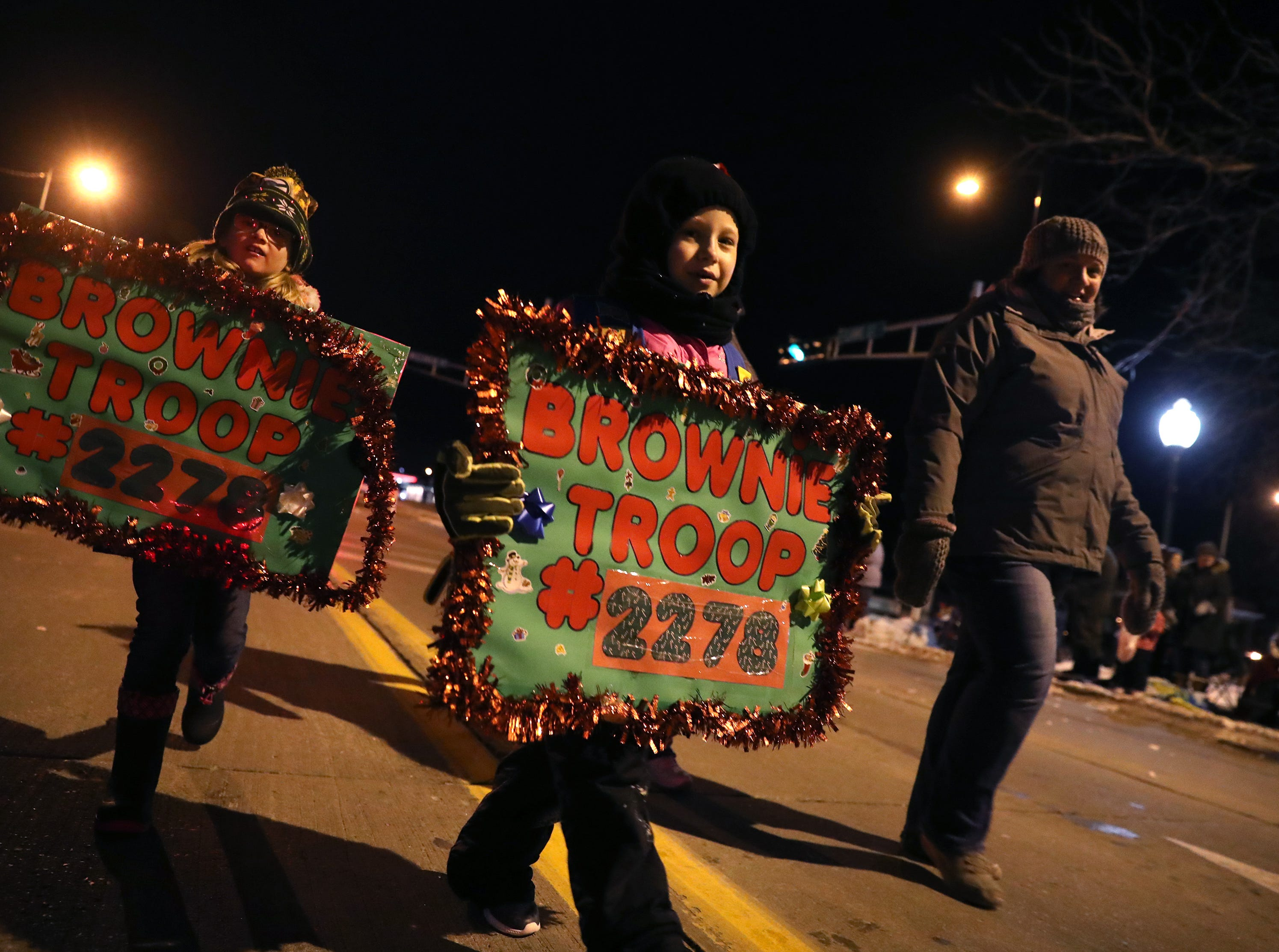Brownie Troop #2278 takes part in the Electric City Christmas Parade Tuesday, Dec. 4, 2018, in Kaukauna, Wis.