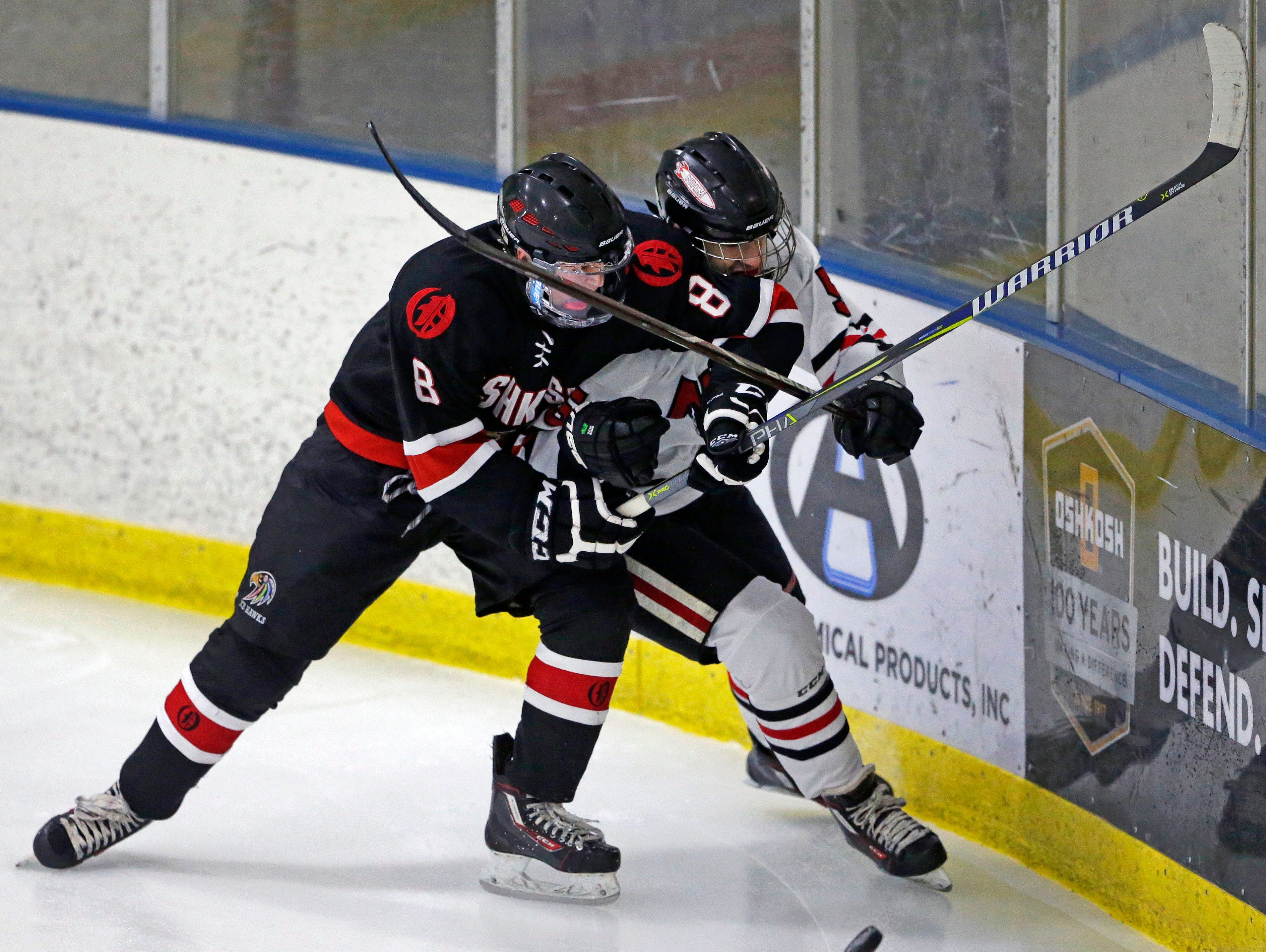 Jacob Sprister of Oshkosh and Aaron Nussbaum of Neenah/Hortonville/Menasha battle for the puck in a Badgerland Conference hockey game Tuesday, December 4, 2018, at Tri-County Ice Arena in Fox Crossing, Wis.Ron Page/USA TODAY NETWORK-Wisconsin