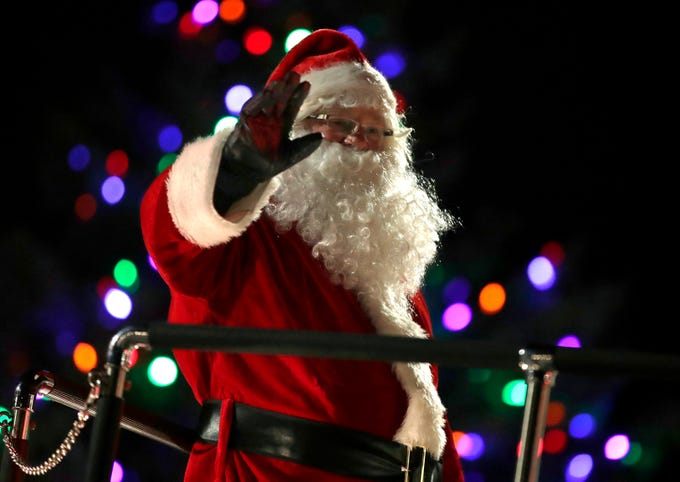 Santa waves to the crowd during the Electric City Christmas Parade Tuesday, Dec. 4, 2018, in Kaukauna, Wis.