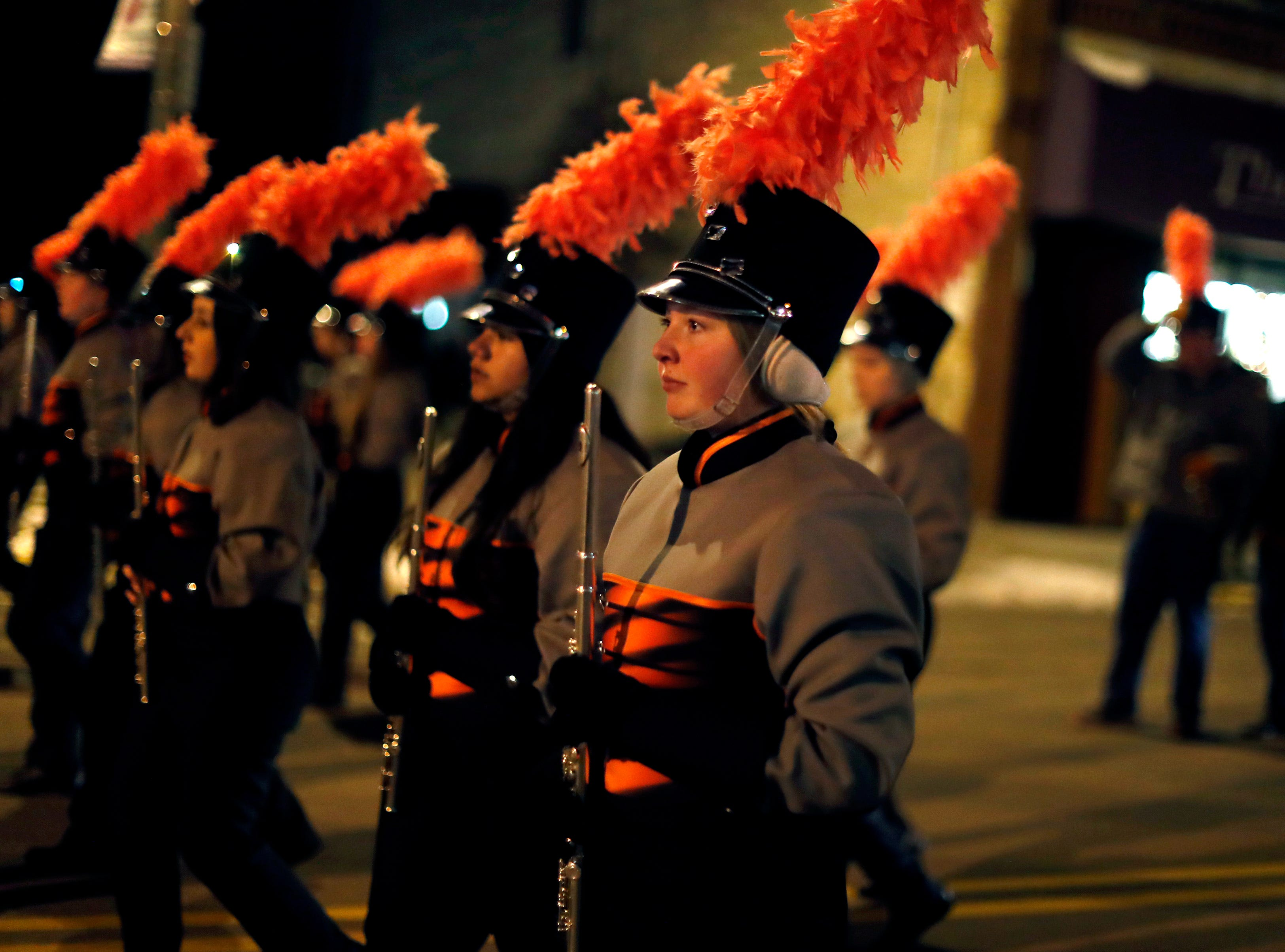 The Kaukauna High School marching band during the Electric City Christmas Parade Tuesday, Dec. 4, 2018, in Kaukauna, Wis.