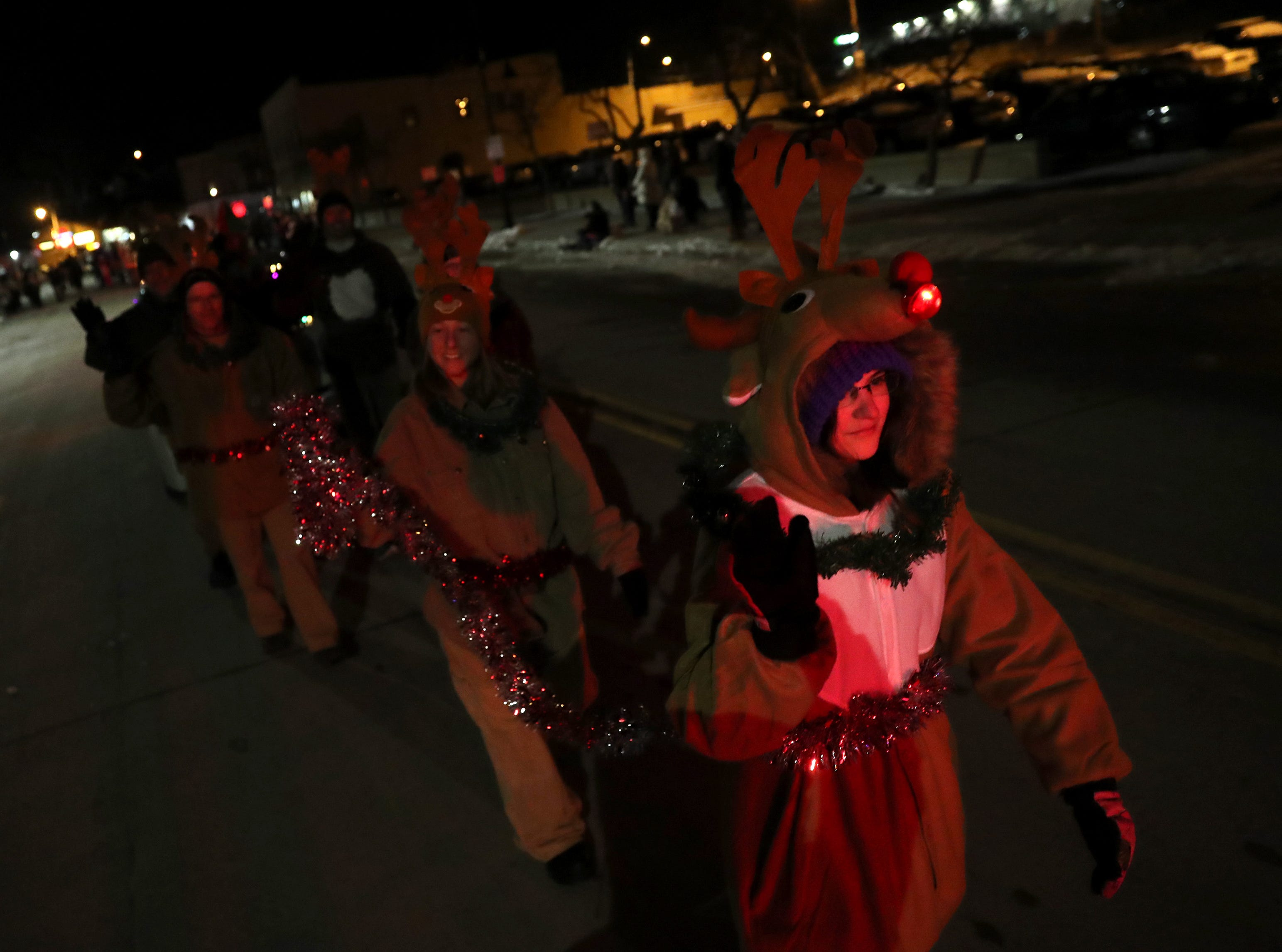 Ghost Town Fitness participates in the Electric City Christmas Parade Tuesday, Dec. 4, 2018, in Kaukauna, Wis.