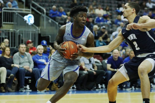 Seton Hall's Myles Cale drives against New Hampshire.