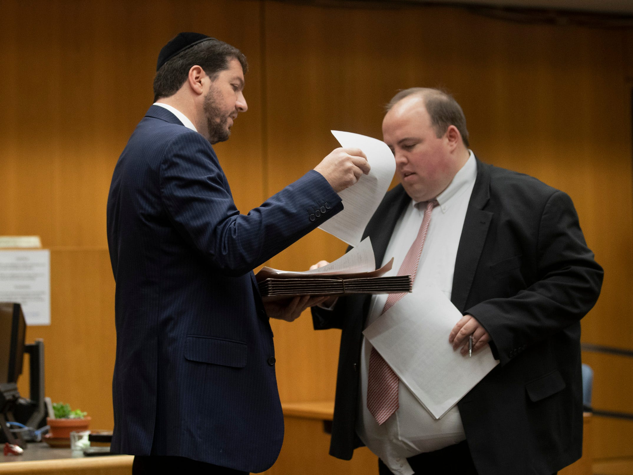 Defense Lawyer Yosef Jacobovitch and Assistant Prosecutor Christopher Heisler go over paperwork prior to court. The first four plea deals in the Lakewood Welfare Fraud cases were settled in front of Judge Wendel Daniels in Ocean County Court in Toms River on December 5, 2018. Twenty Six people were arrested in the raids in 2017.