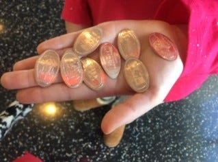 An old-fashioned souvenir at the top of One World Trade Center: flattened pennies, embossed with eight different images