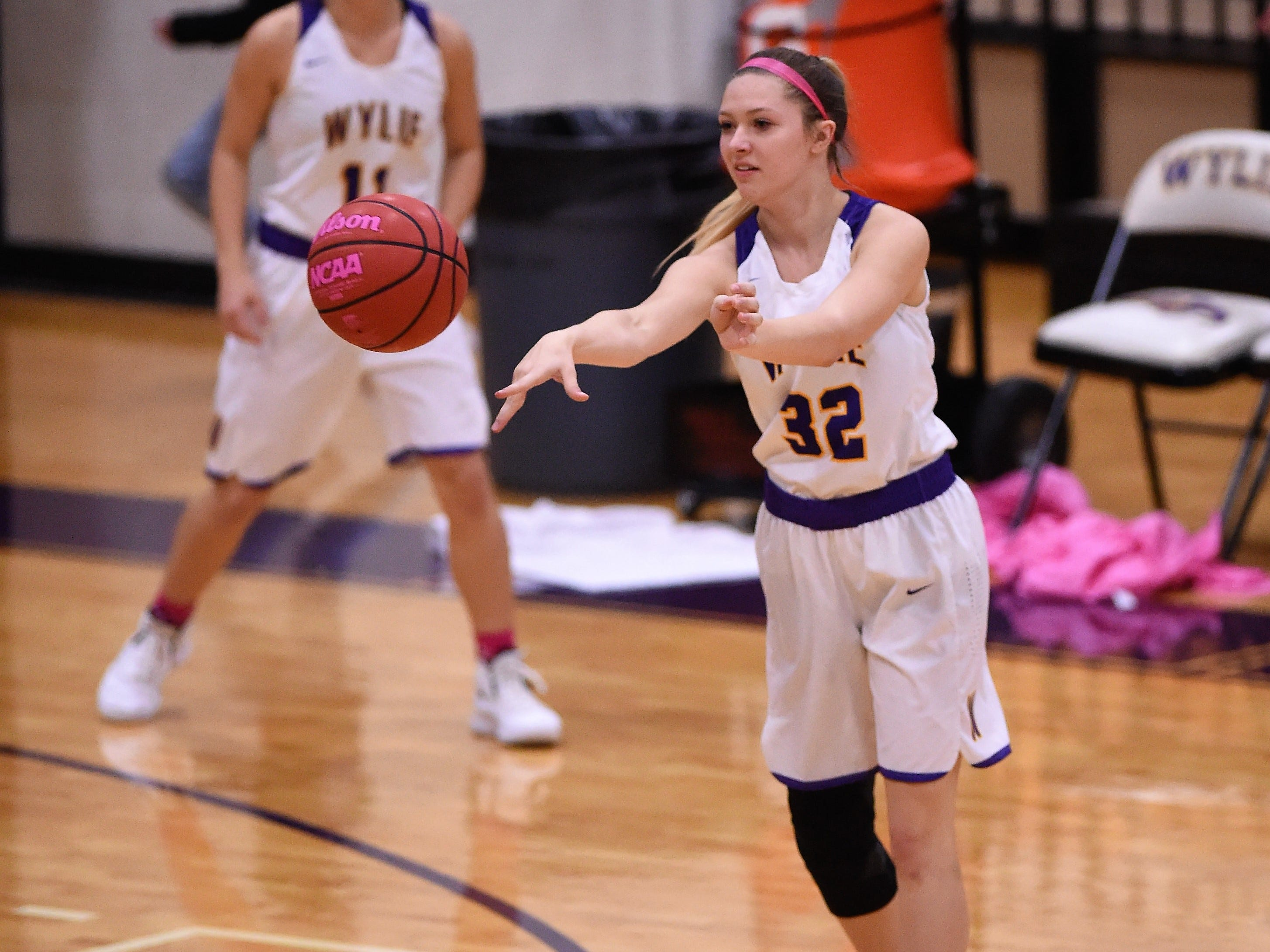 Wylie guard Skylar Williams (32) passes the ball against Merkel in the Coaches vs. Cancer Pink Out game on Tuesday, Dec. 4, 2018. The Lady Bulldogs won 75-39.